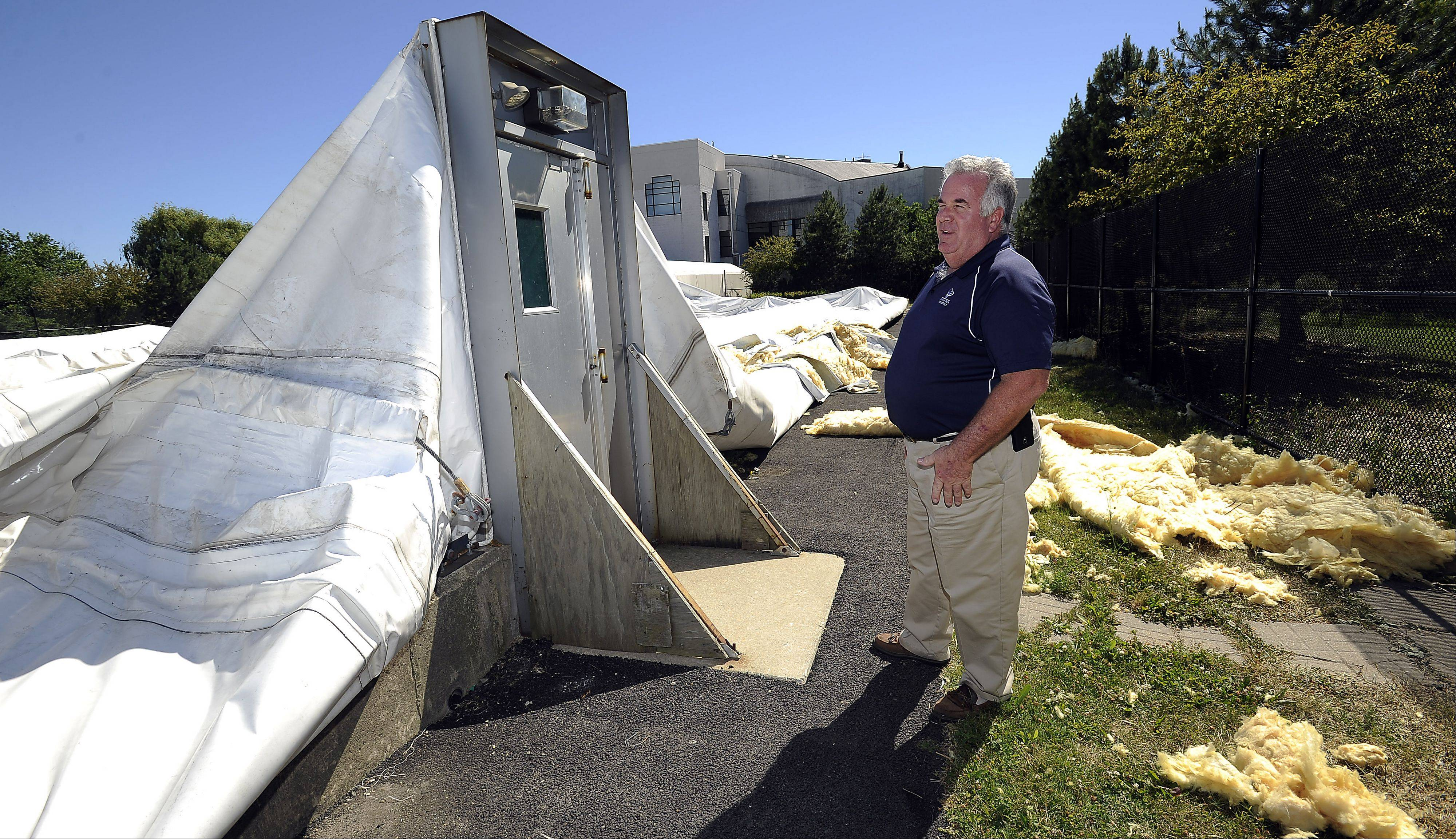 Hanover Park Park District's Bob O'Brien, superintendent of parks and planning, stands at one of the doorways now blocked by the inflatable tennis dome that collapsed Sunday afternoon. None of the roughly 20 people inside was injured.