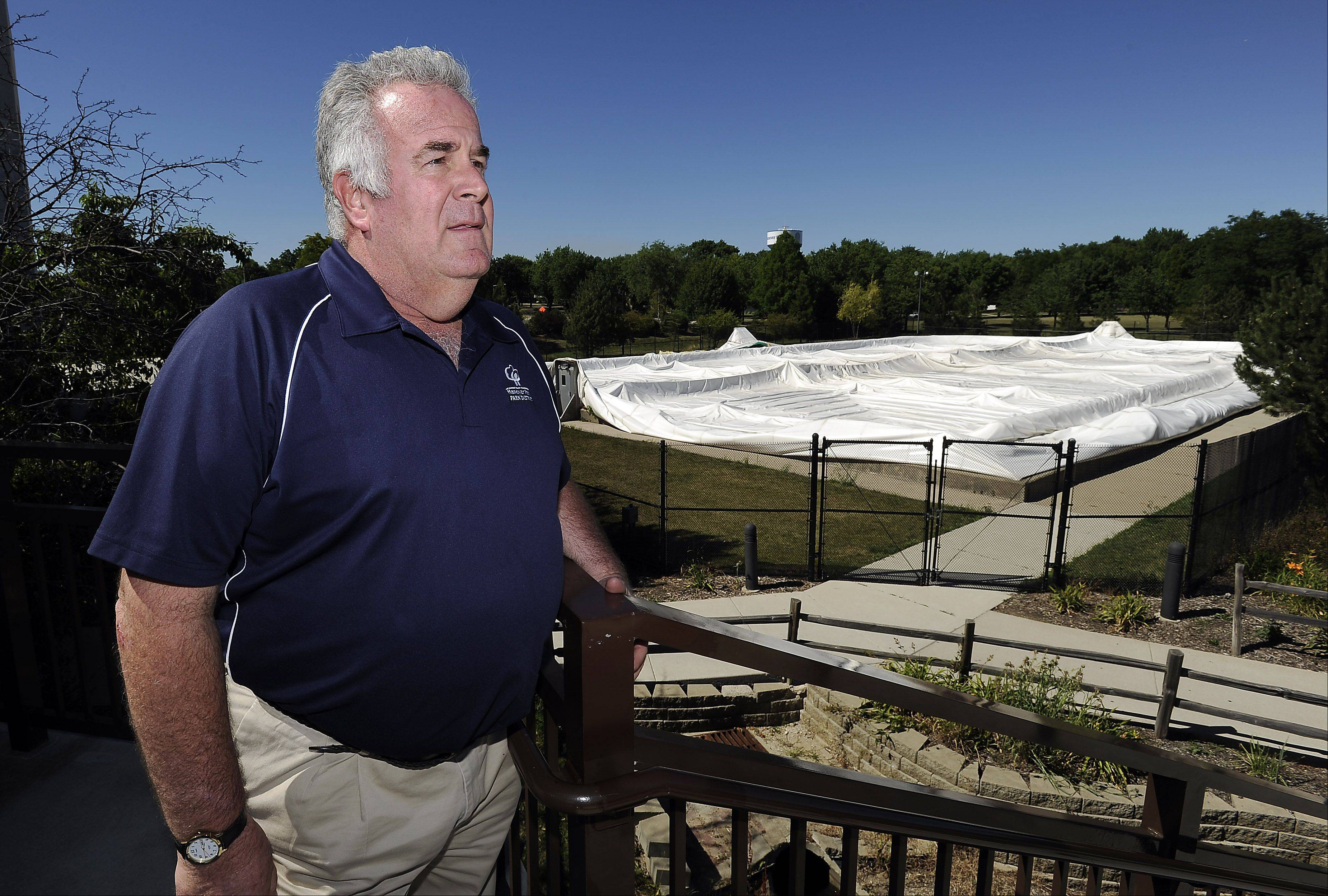 Hanover Park Park District's Bob O'Brien, superintendent of parks and planning, looks over the inflatable tennis dome that collapsed Sunday afternoon. None of the roughly 20 people inside was injured.