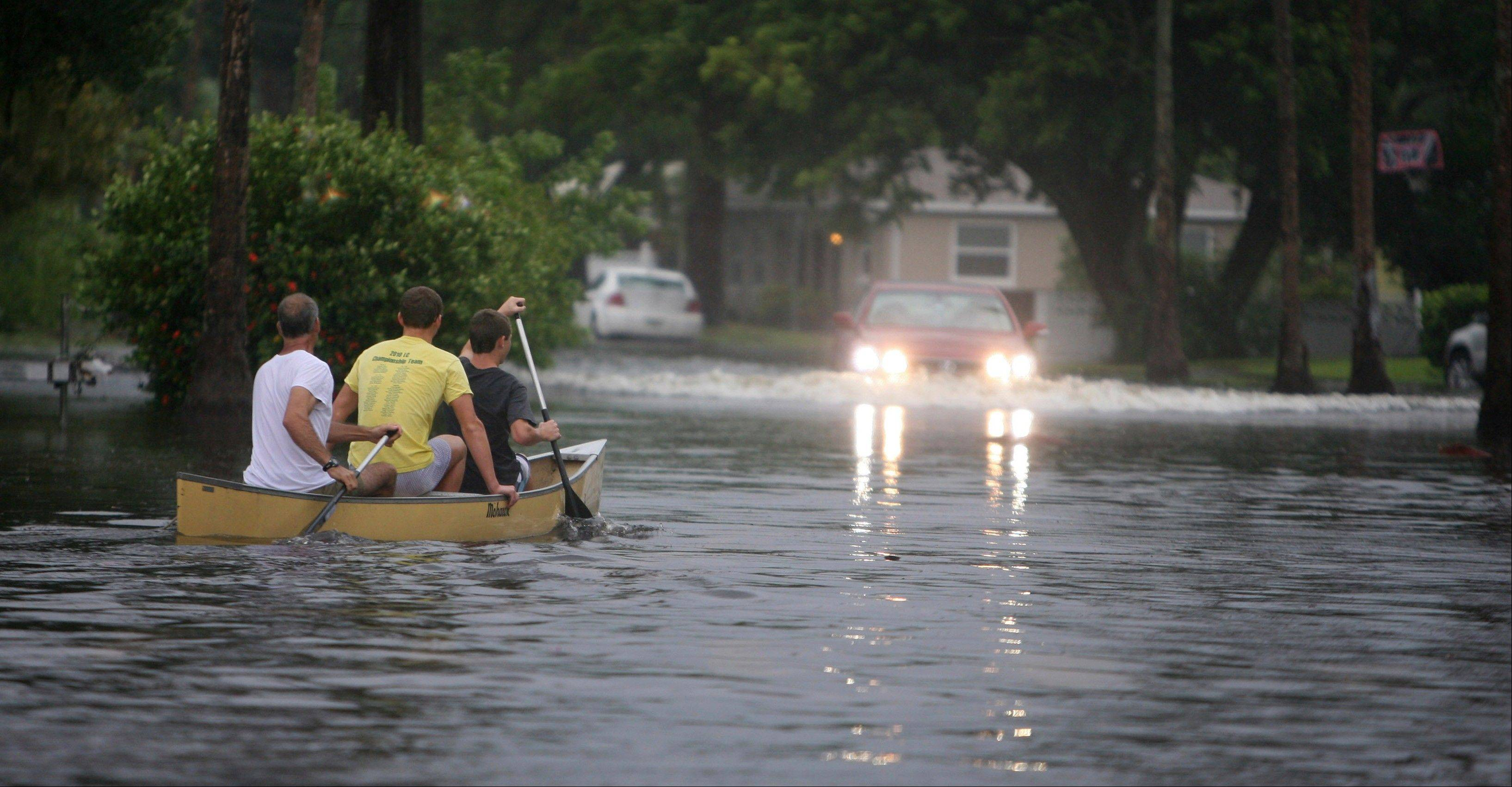 Canoe-goers navigate flooded streets as flooding continues to worsen and Tropical Storm Debby pounds the Tampa Bay, Fla., area Sunday, June 24, 2012. Tropical Storm Debby continued to churn in the Gulf of Mexico.