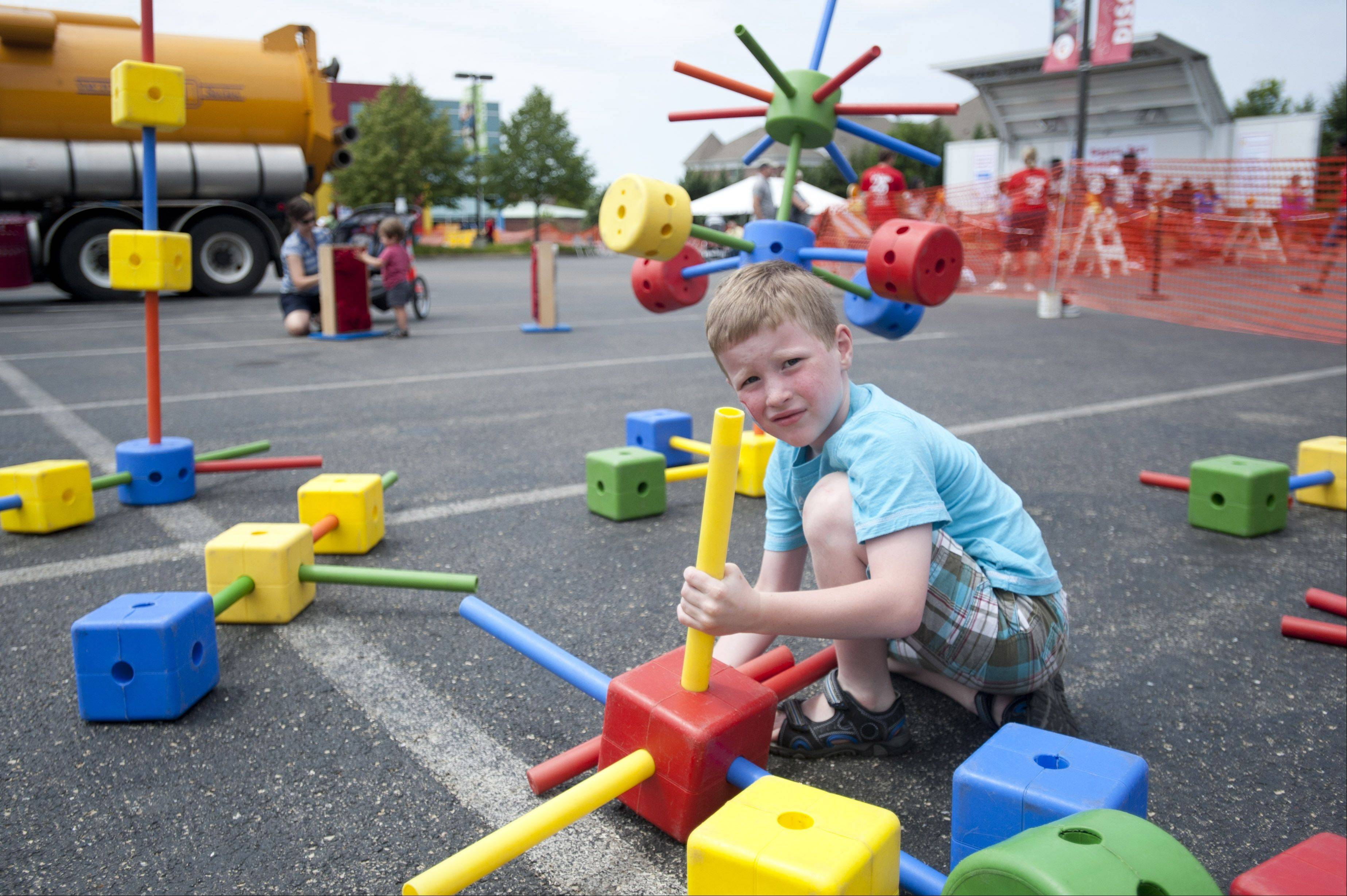 Braeden Meeker, 6, plays with building blocks Sunday during the DuPage Children's Museum's 25th anniversary celebration. Those who attended enjoyed train rides, art activities, live music and the ever popular Touch-a-Truck outside the museum.