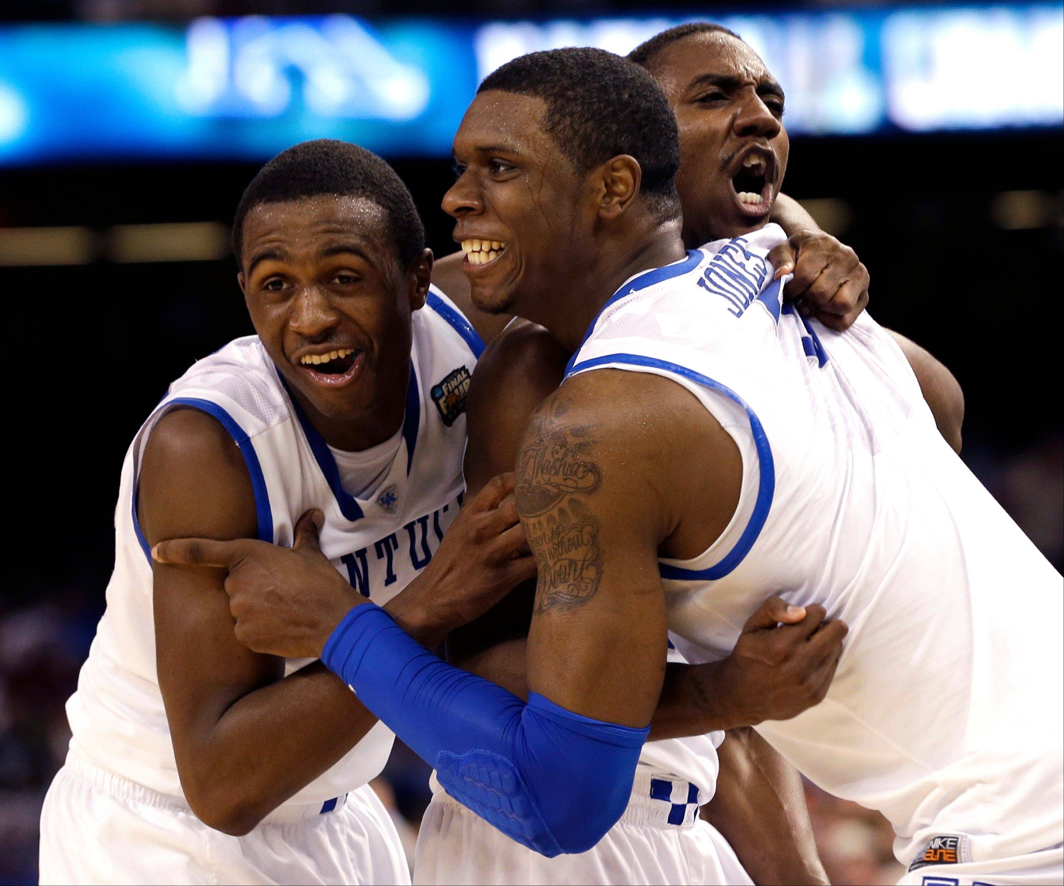 Kentucky guard Doron Lamb,left, forward Terrence Jones (3) and guard Marquis Teague celebrate after the NCAA Final Four tournament college basketball championship game Monday, April 2, 2012, in New Orleans.