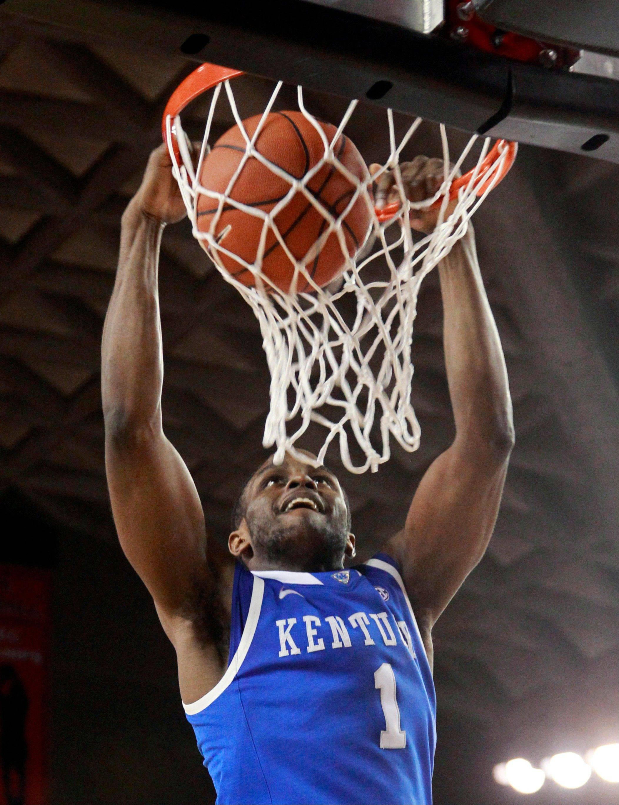 Kentucky guard Darius Miller scores in the second half of Kentucky's 57-44 win over Georgia in an NCAA college basketball game Tuesday, Jan. 24, 2012, in Athens, Ga.