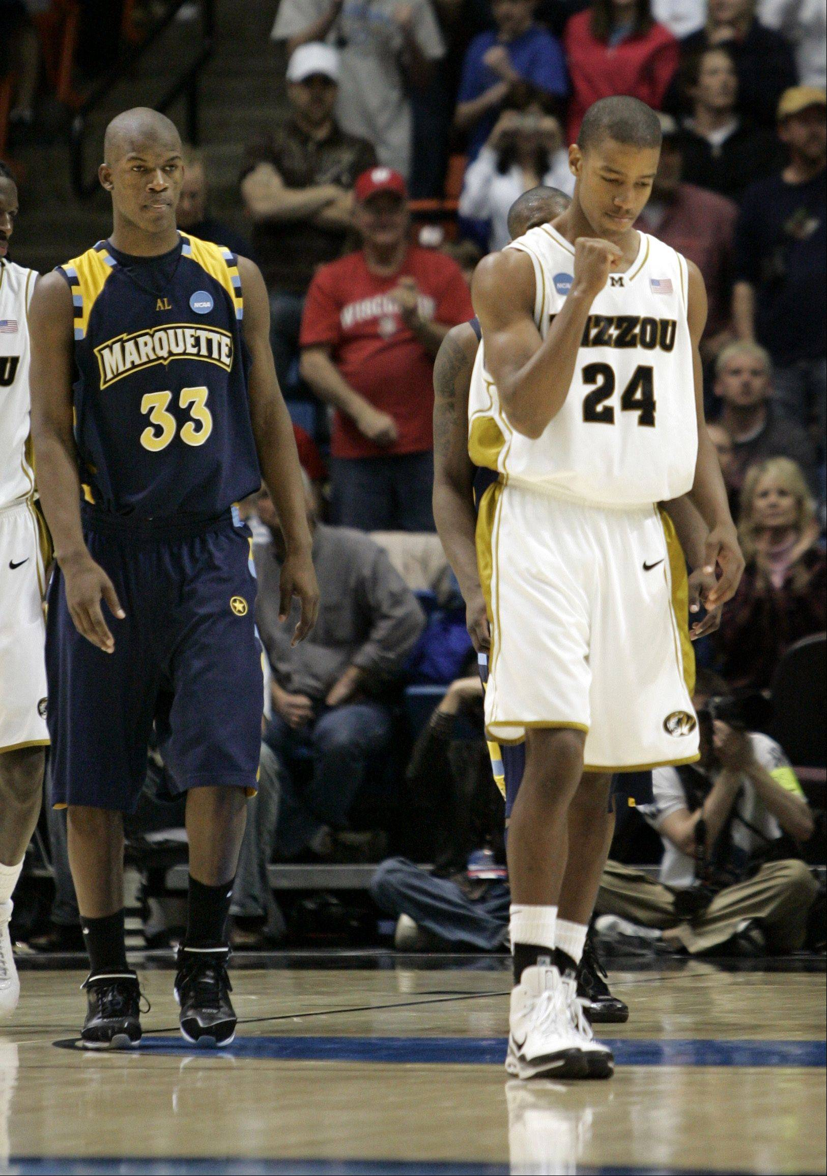 Missouri guard Kim English (24) celebrates in front of Marquette guard Jimmy Butler (33) after scoring two free throws to help defeat Marquette 83-79 in the last seconds of a second-round men's NCAA college basketball tournament game in Boise, Idaho, Sunday, March 22, 2009.