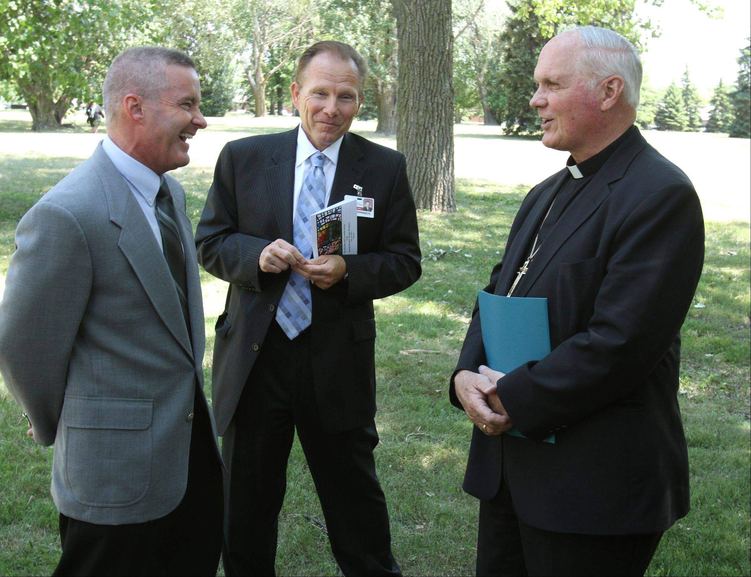 Most Reverend George Rassas Auxiliary Bishop of Chicago, right, has a laugh with Elk Grove Village Mayor Craig Johnson, left, and John Werrbach, president and CEO of Alexian Brothers Medical Center at Alexian Brothers Health System groundbreaking for a $7.5 million free-standing hospice residence in Elk Grove Village on Tuesday.