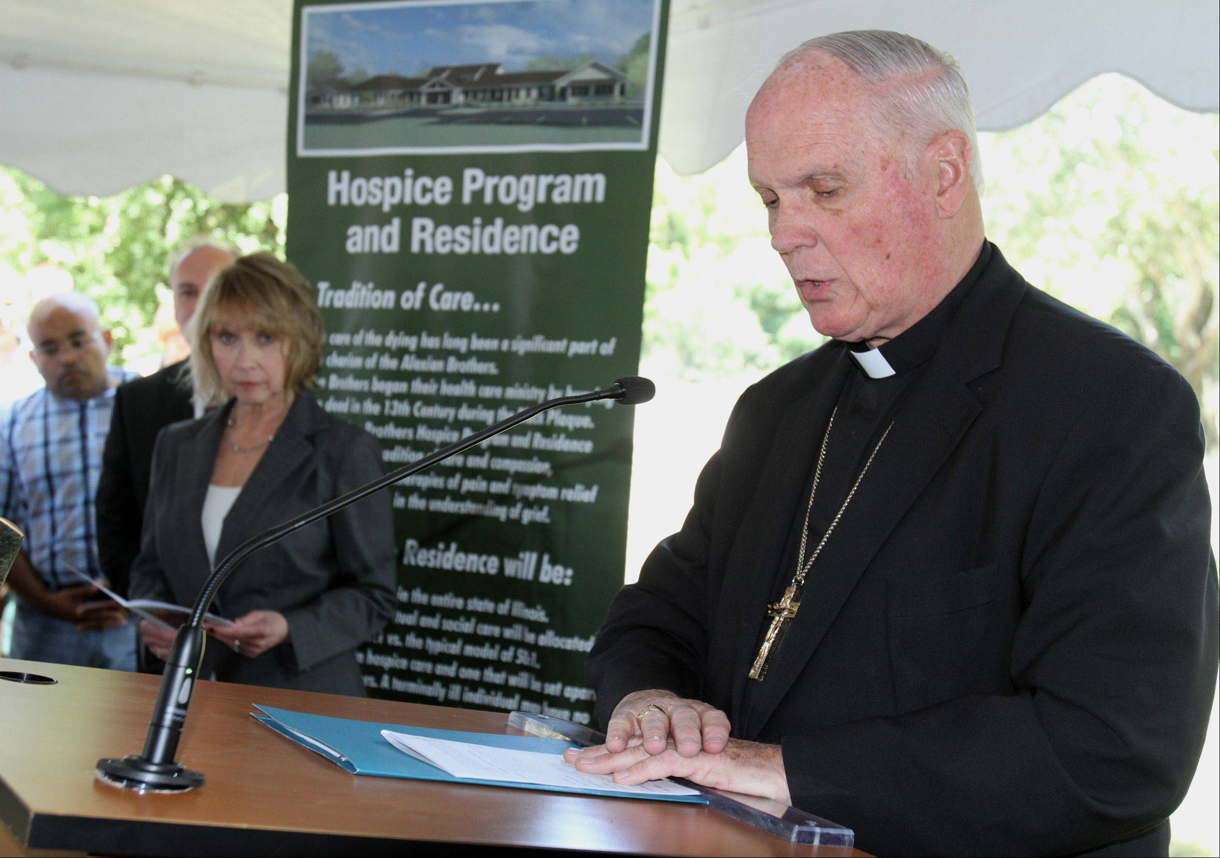 Most Reverend George Rassas Auxiliary Bishop of Chicago says a prayer at Alexian Brothers Health System hospice center groundbreaking.