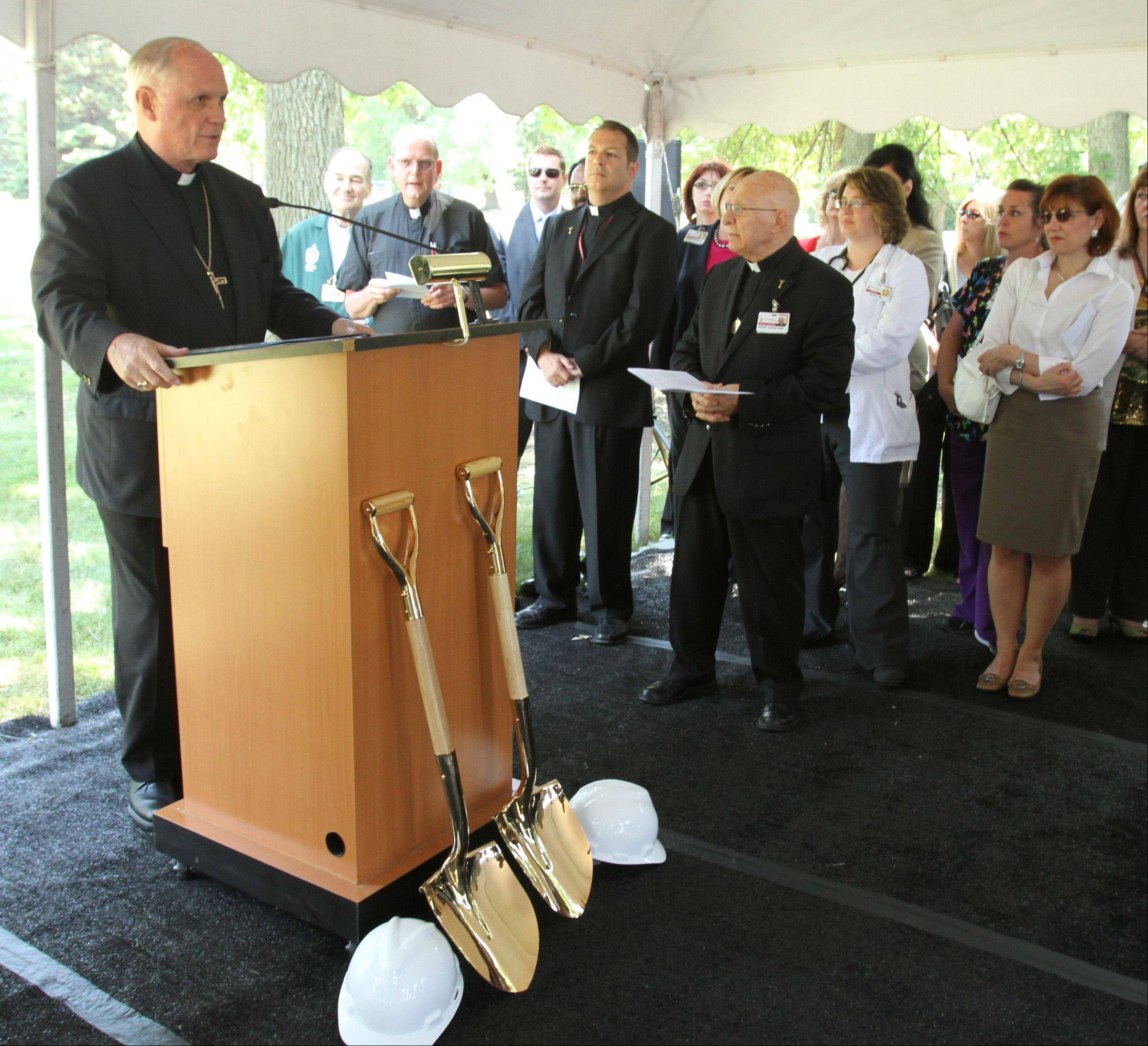 Most Reverend George Rassas Auxiliary Bishop of Chicago speaks at the Alexian Brothers Health System groundbreaking for a $7.5 million free-standing hospice residence in Elk Grove Village on Tuesday.