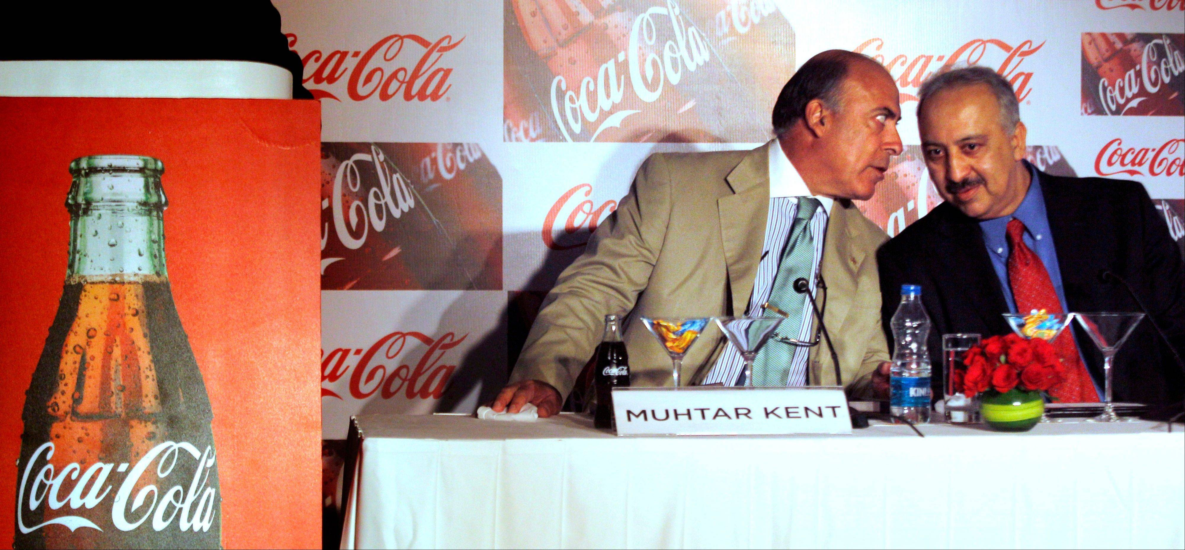 Chairman and CEO of The Coca-Cola Co., Muhtar Kent, left, speaks to President and CEO of Coca Cola India and South West Asia Atul Singh during a meeting in New Delhi, India, Tuesday..