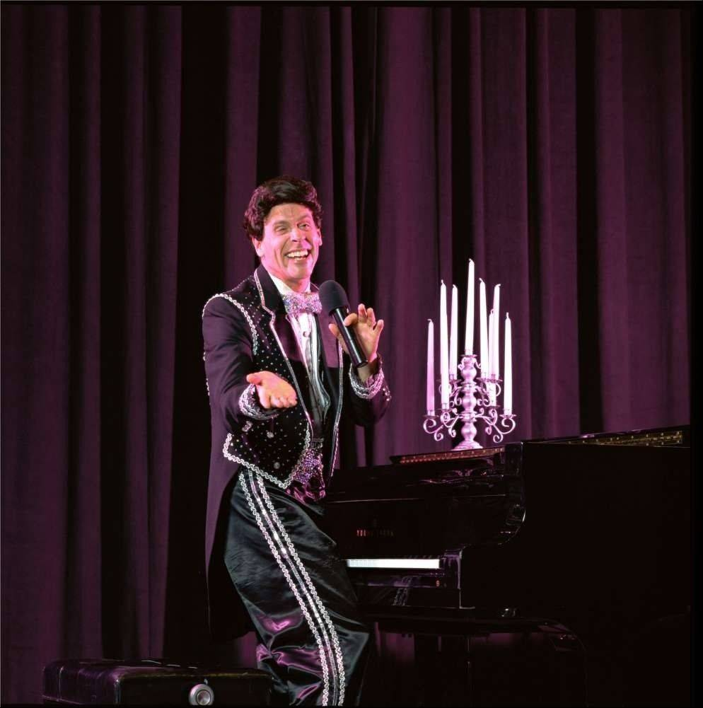 "Brian Gurl appears as the late pianist Liberace in ""Laughing with Legends"" at the Metropolis Performing Arts Centre in Arlington Heights."