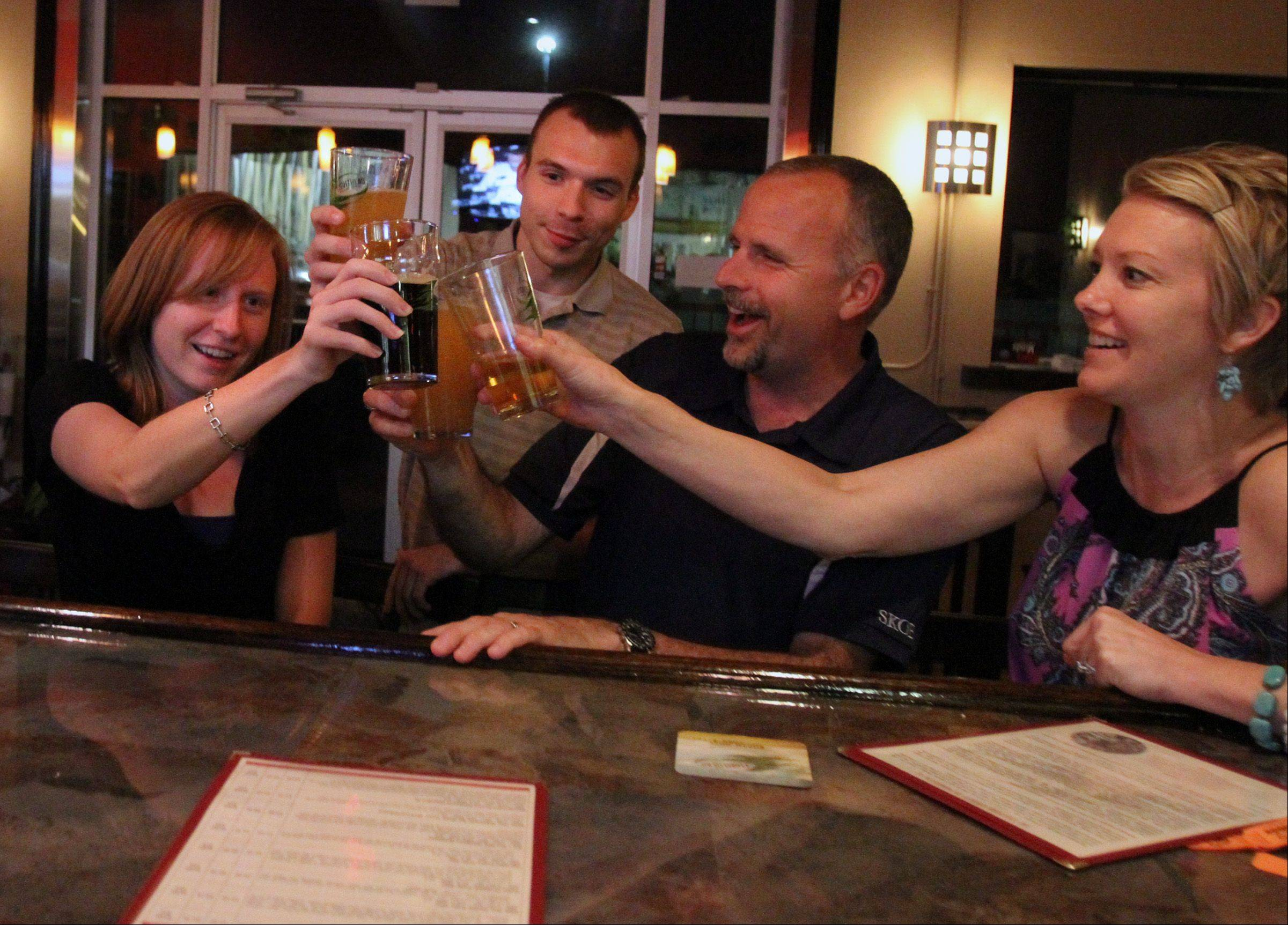 Erinn Vincent, left, of Wauconda celebrates her 26th birthday with friends at Tighthead Brewing Company in Mundelein.