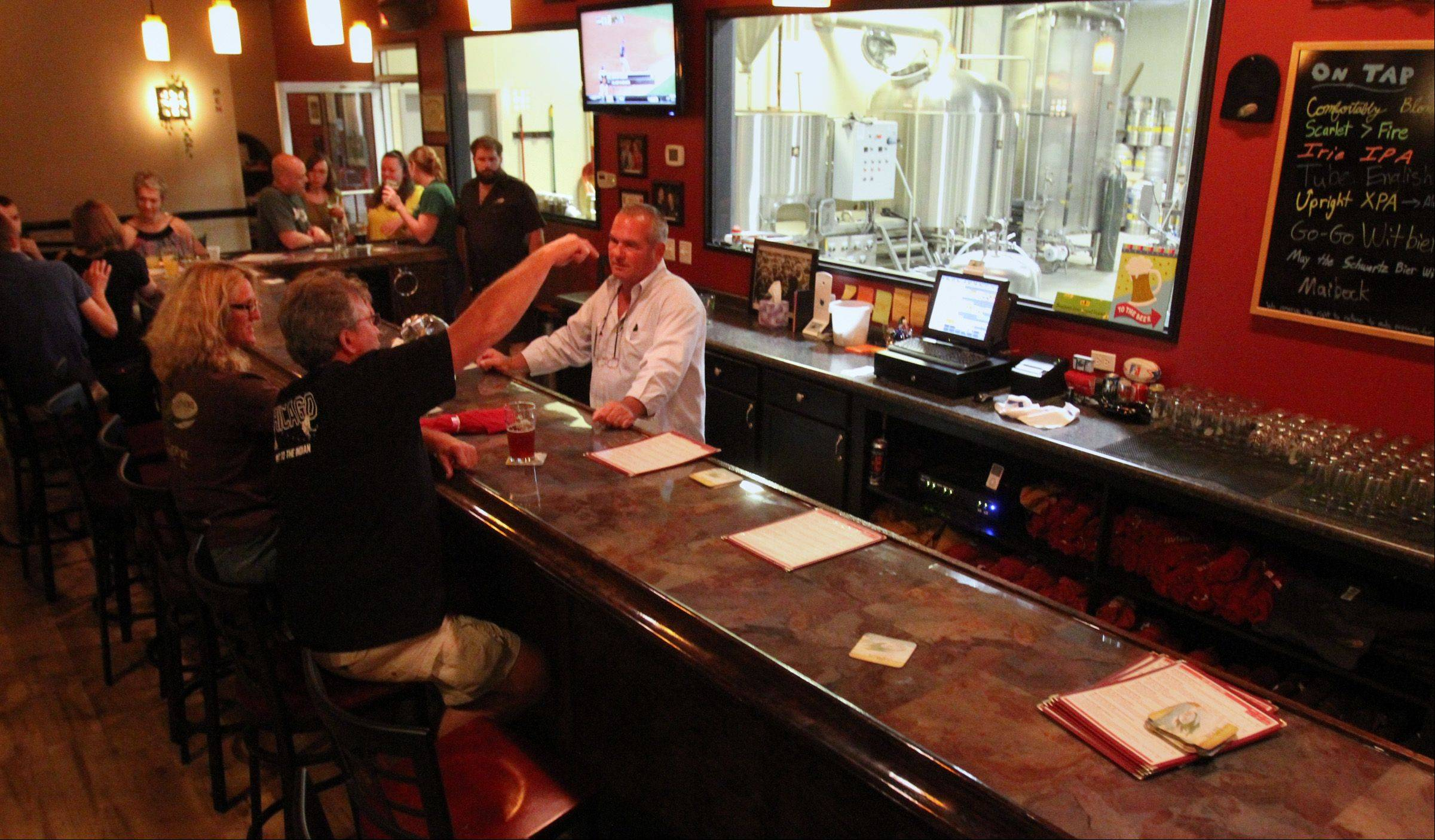Customers can view Tighthead's brewery from the bar.