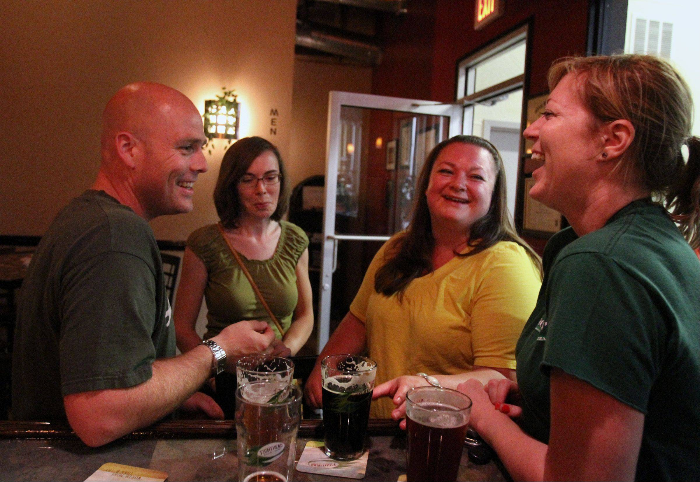 Pat O'Connell, left, Pat's wife Christina O'Connell, right, and Abby Hickman, far right, all of Libertyville, enjoy a night out at Tighthead Brewing Company in Mundelein.