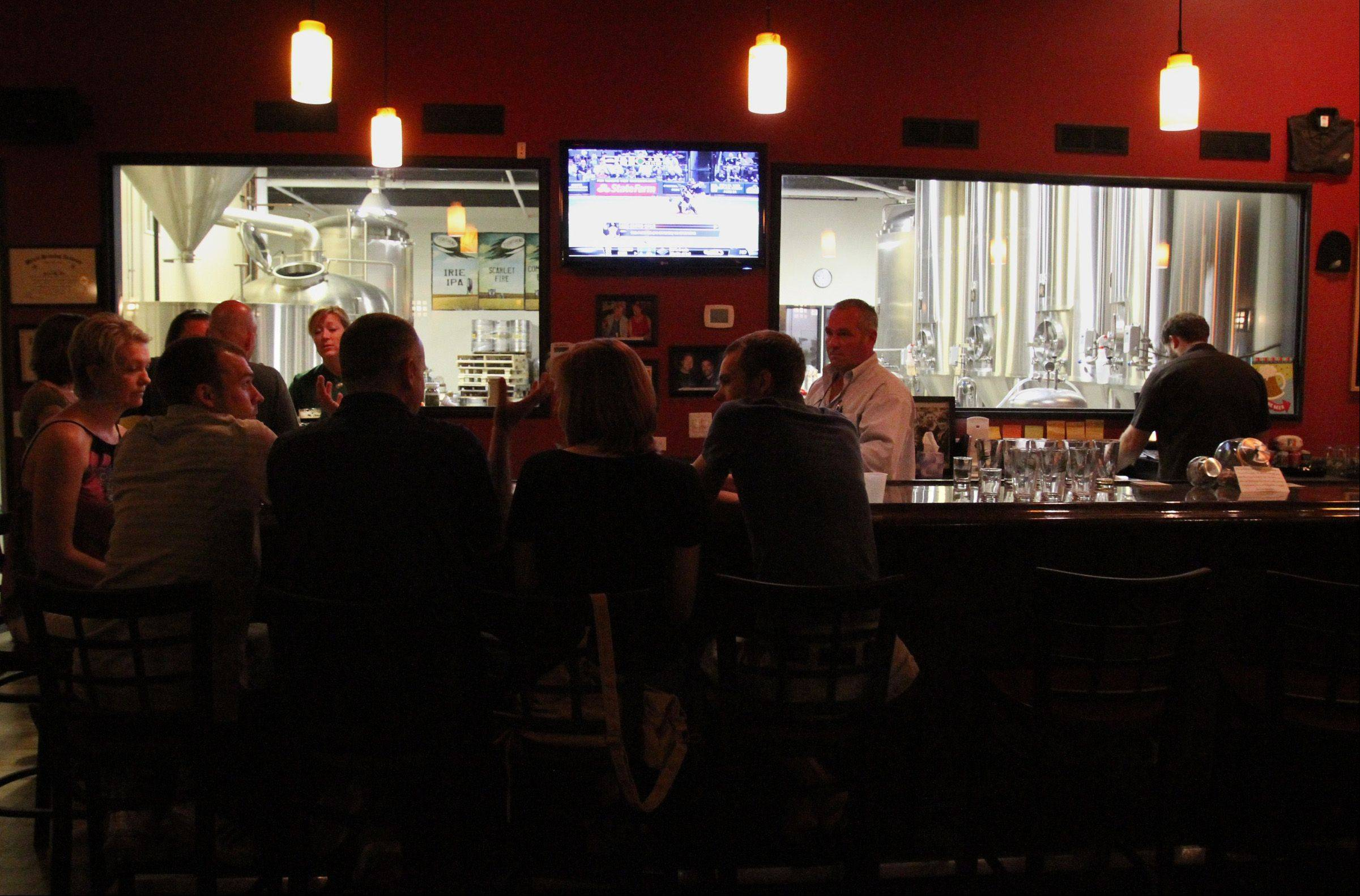 Tighthead Brewing Company's tap room view allows customers to view the brewery from the bar.
