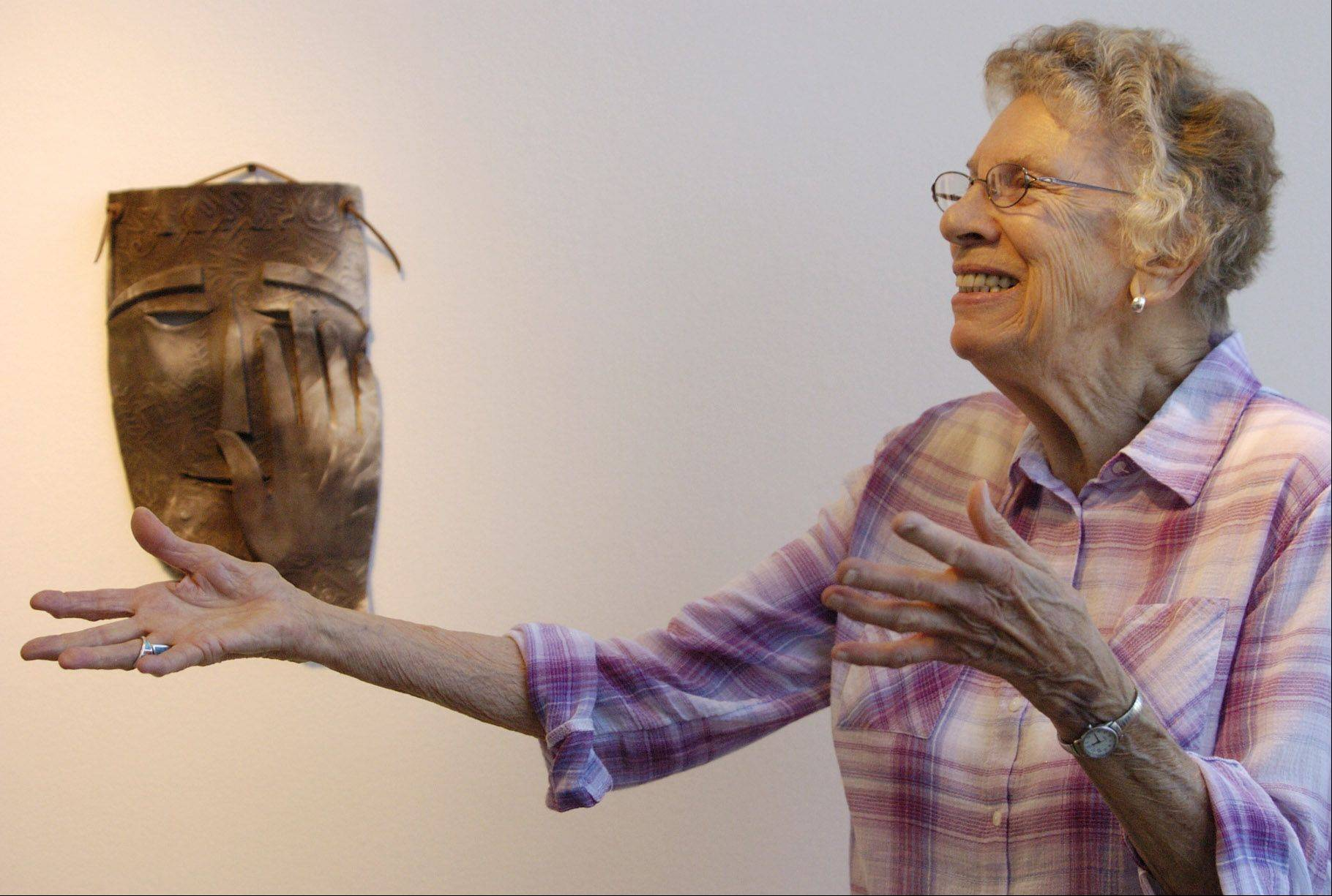 Mary Applegate, a former grade school teacher turned artist, thanks everyone for coming to the reception for her exhibition of sculpture at Harper College. The 89-year-old Palatine artist's work is on display at the college through July 18.
