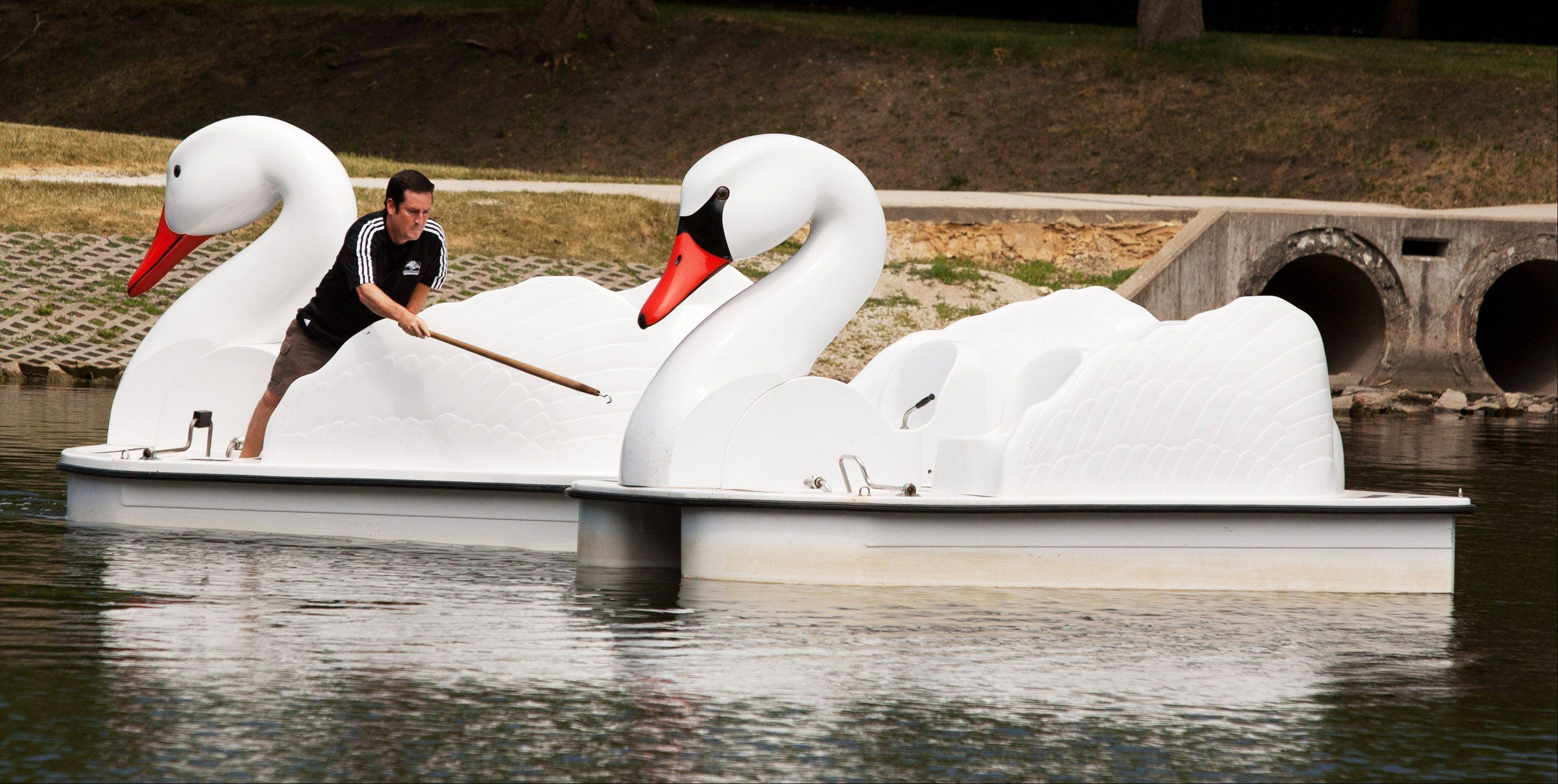 Tim Reinbold of the Oakbrook Terrace Park District corrals a loose paddle boat at the Lake View Nature Center. The paddle boats are one of several activities available to visitors during Wild Wednesdays.
