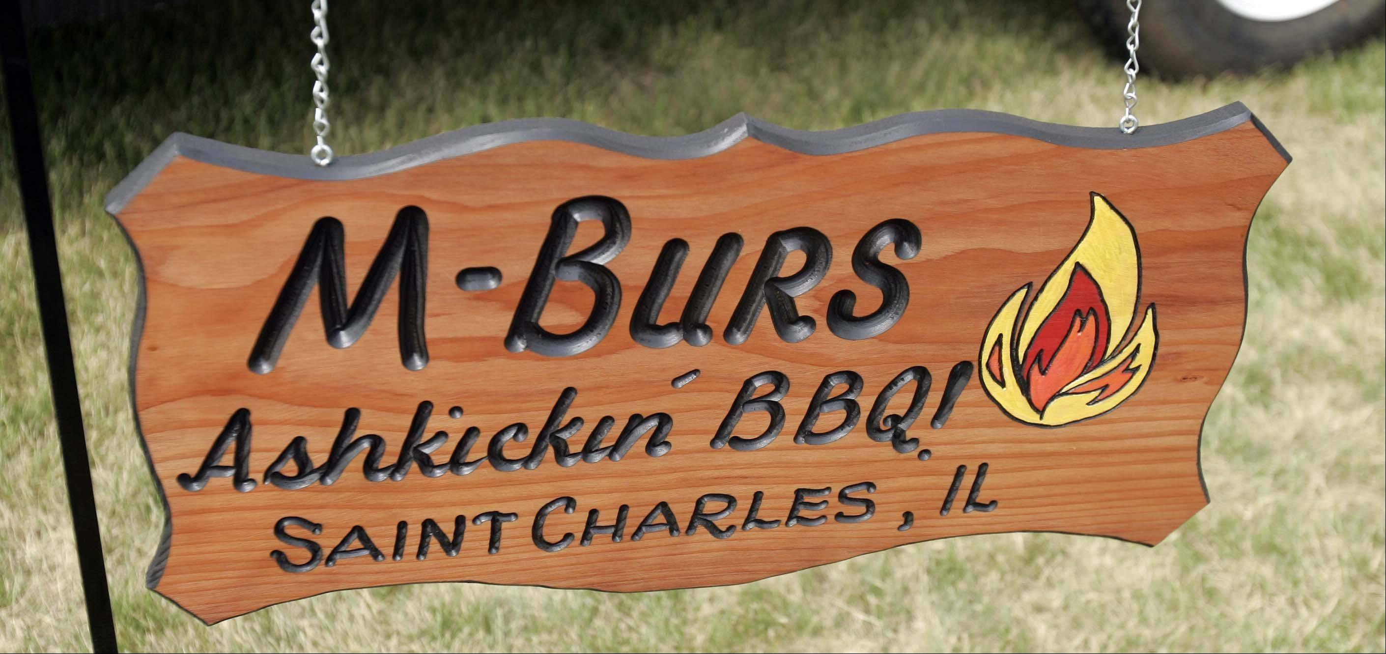 The MBurs sign hangs in front of Matt and Marty Burton's custom barbecue trailer.