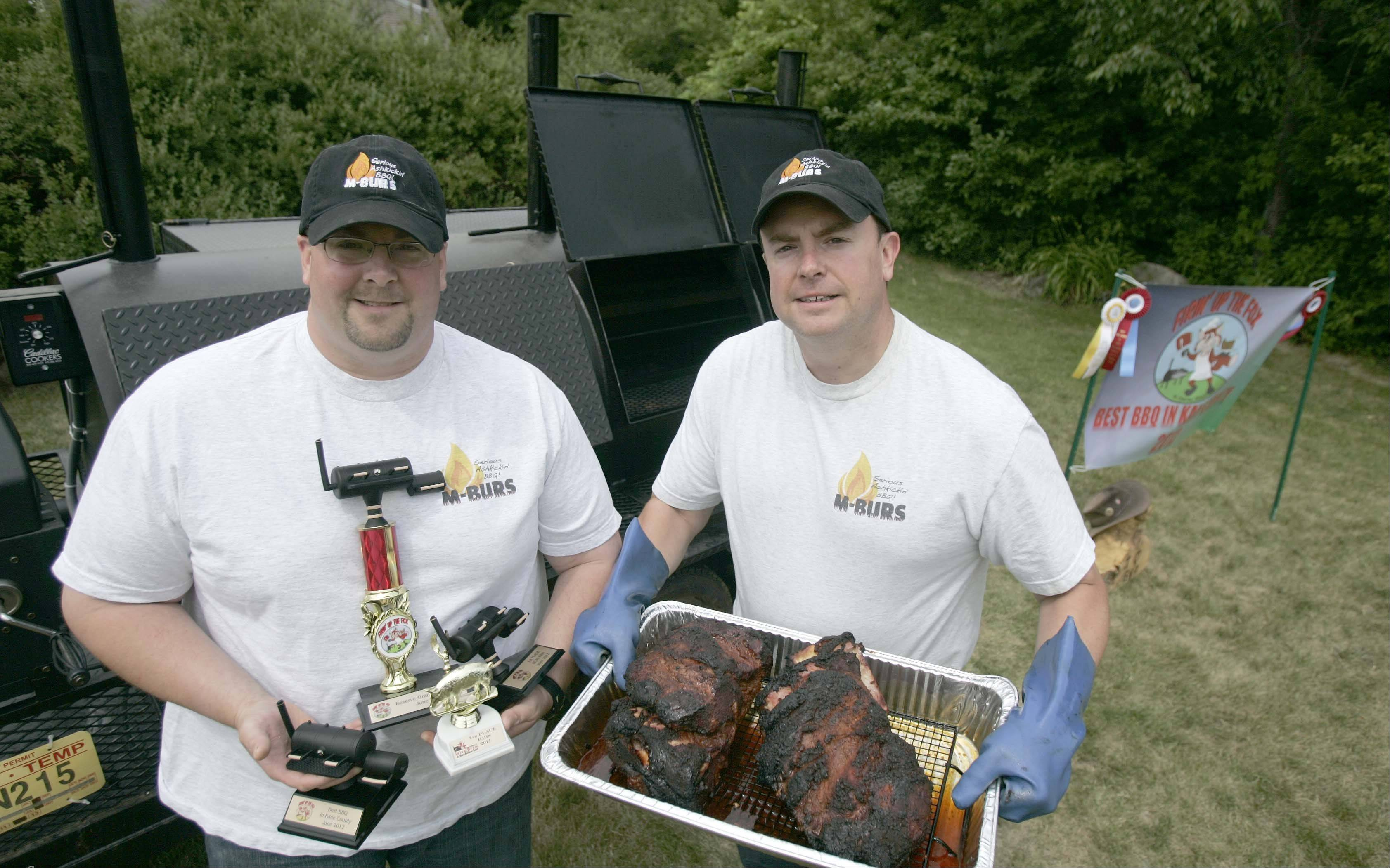 Brothers Marty, left, and Matt Burton of St. Charles won the Best Barbecue in Kane County title at the St. Charles Riverfest. The pair took first in ribs, second in brisket, fourth in pork, fifth in side dish and the Reserve Grand Champion for the Kansas City Barbecue Society. This was only the second time they had competed with their custom built barbecue/smoker.
