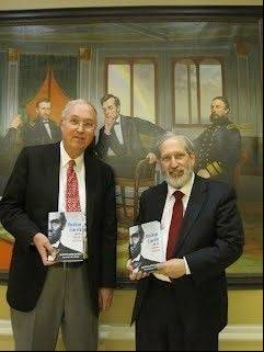 Authors Dan Van Haften, left, and David Hirsch pose with the book they wrote after studying the speeches of Abraham Lincoln.