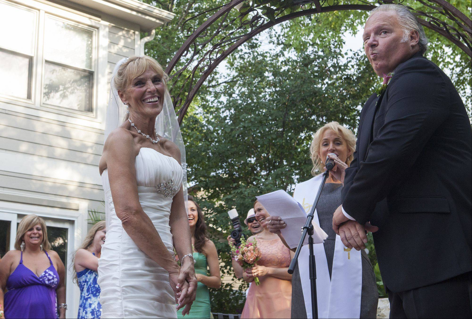 Mike Conjura makes a face to the crowd after Libby Watkins made a funny remark during their vows.