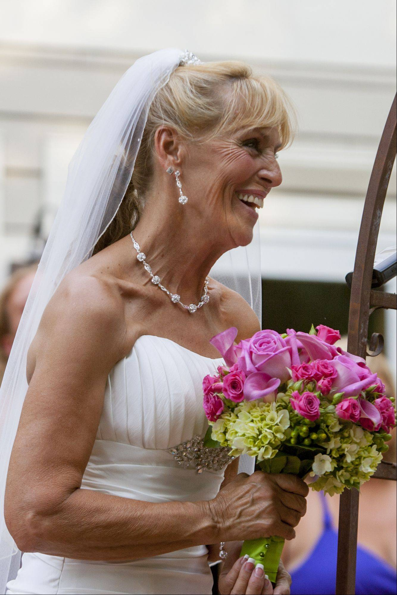Libby Watkins laughs with excitement before getting married to Mike Conjura.