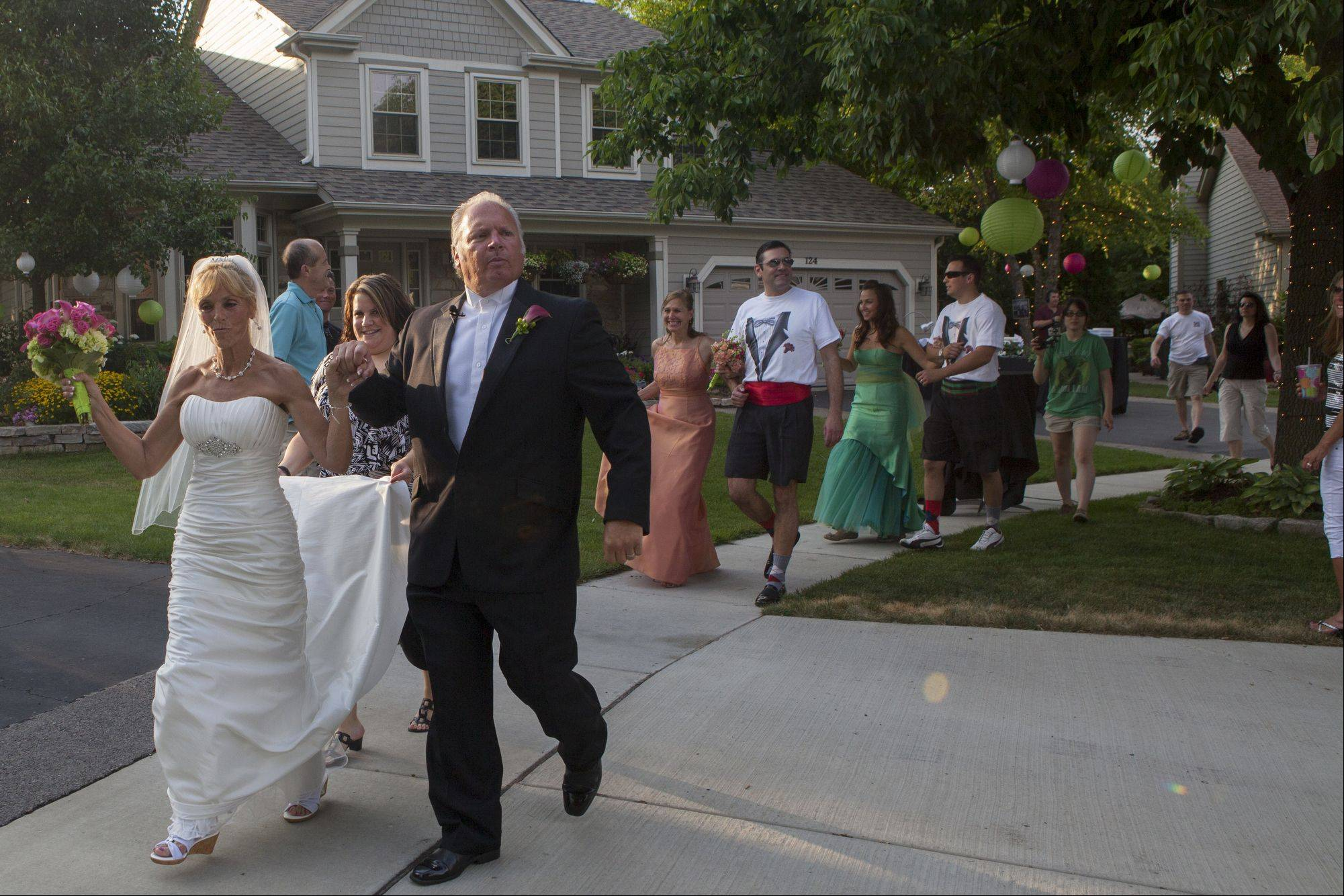 Libby Watkins and Mike Conjura surprised their family and friends on Sunday when they decided to have a flash mob wedding at their home in Schaumburg.