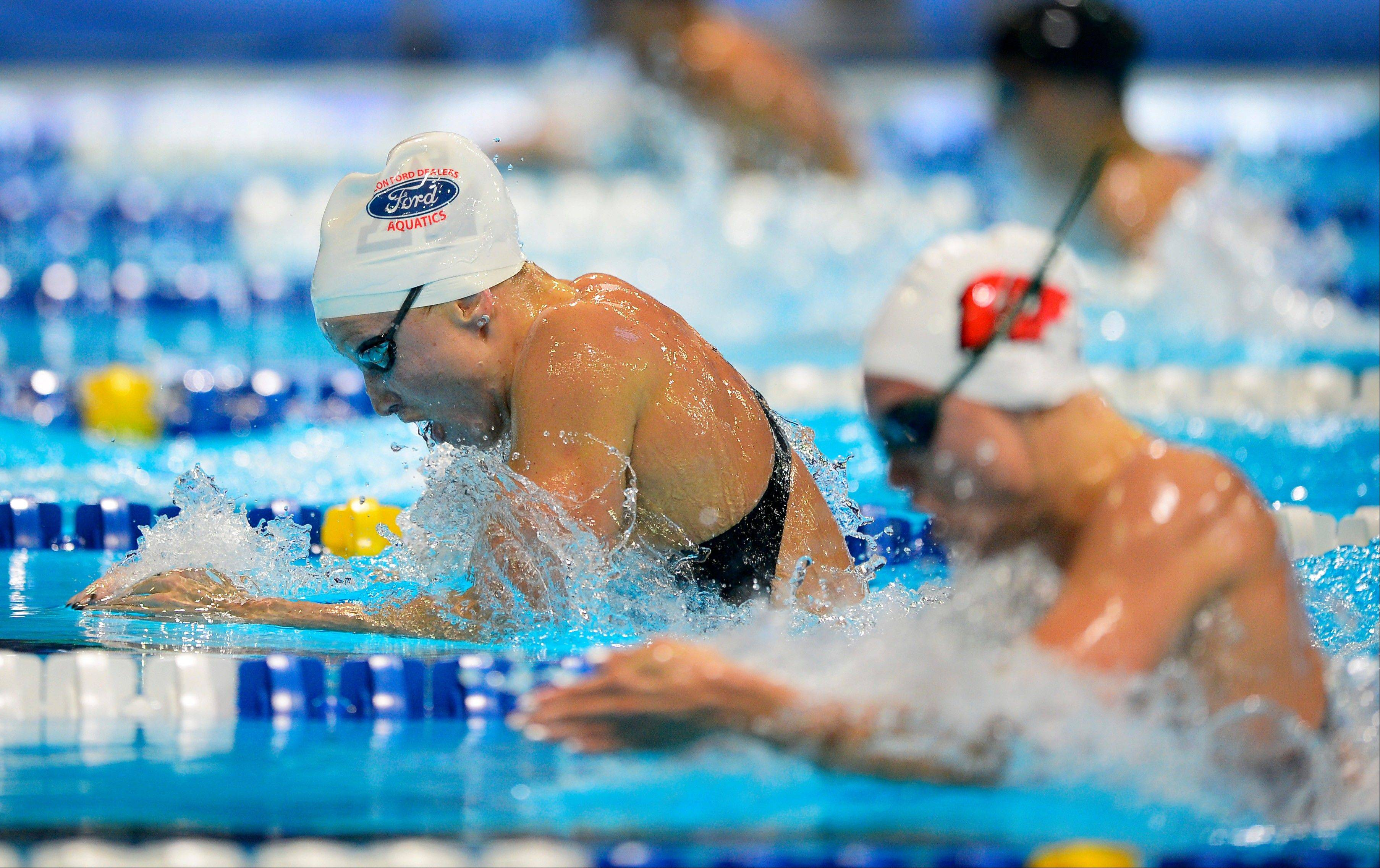 Annie Chandler, left, swims in the women's 100-meter breaststroke semifinals at the U.S. Olympic swimming trials Tuesday. At right is Stevenson High School product Ashley Wanland, who advanced to Wednesday's finals.