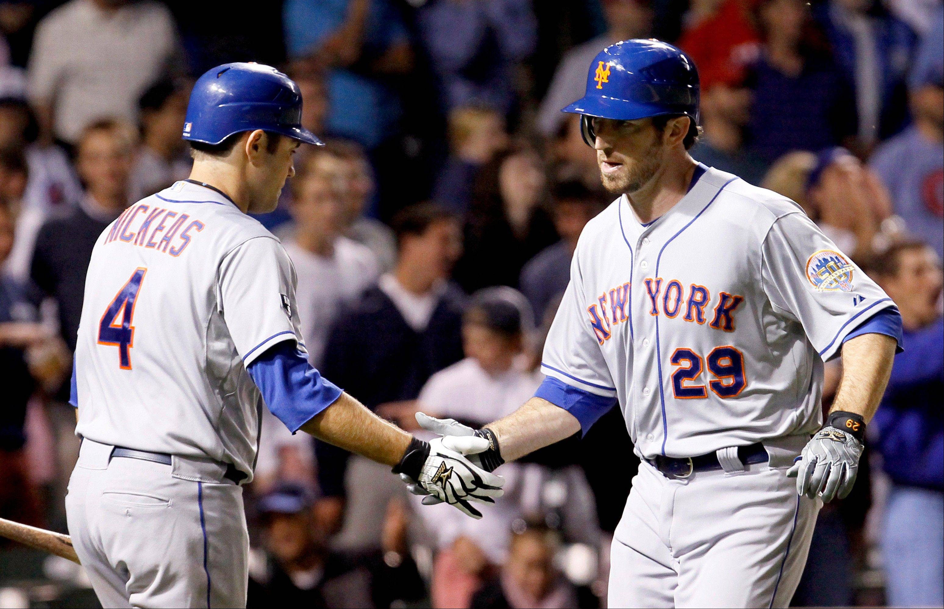 New York Mets first baseman Ike Davis, right, has a perspective on what the Cubs' Anthony Rizzo might be going through.