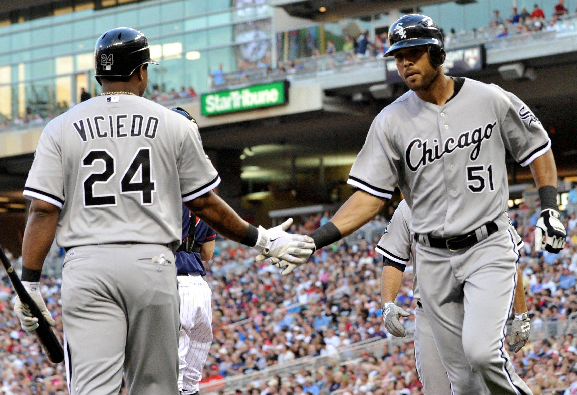 Chicago White Sox right fielder Alex Rios, right, is congratulated by Dayan Viciedo after hitting a two-run home run off Minnesota Twins pitcher Liam Hendriks Tuesday during the fourth inning.