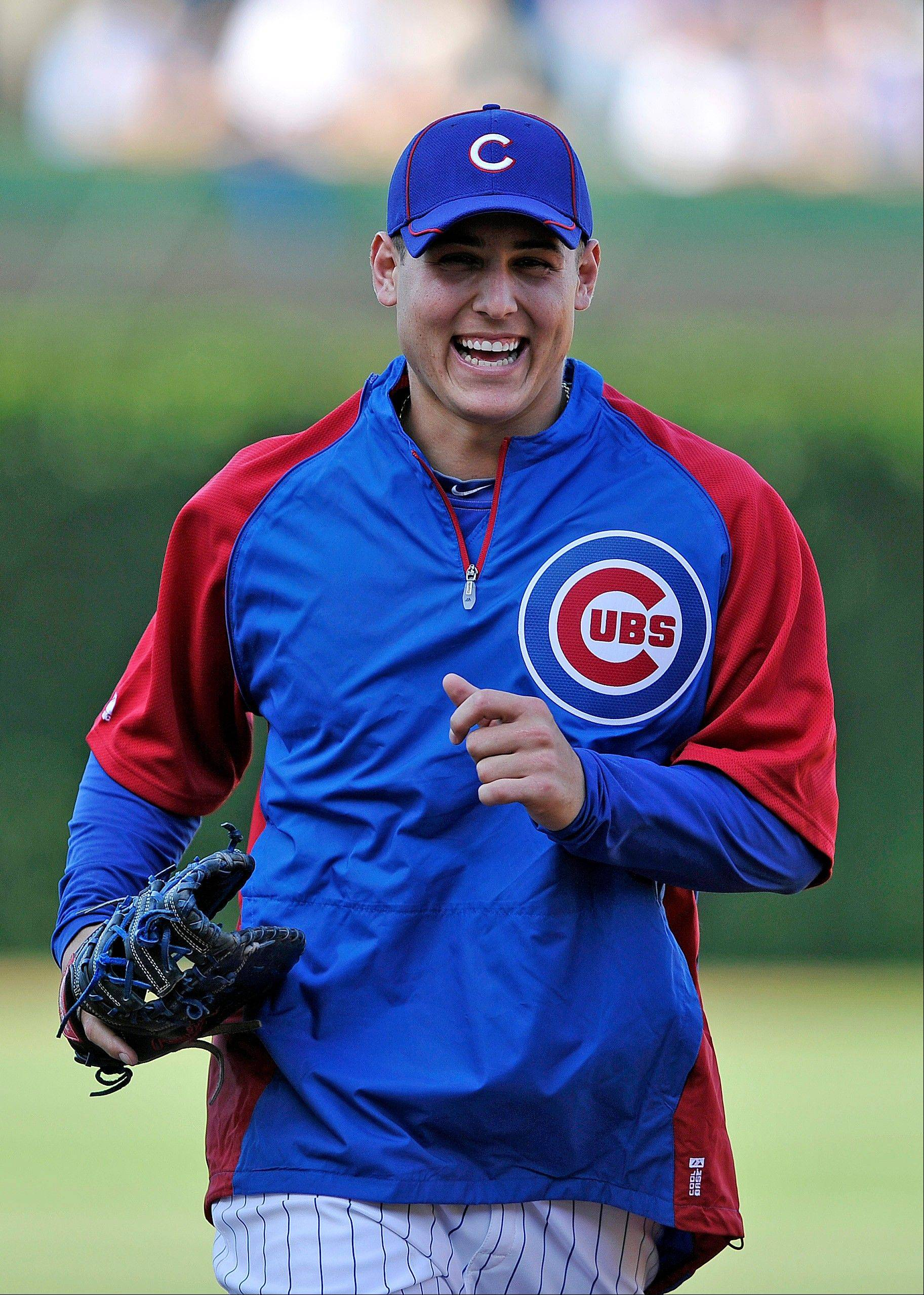 Cubs first baseman Anthony Rizzo runs off the field after batting practice Tuesday at Wrigley Field. The Cubs recalled Rizzo from Triple-A Iowa and put him in the No. 3 spot in the batting order for his Chicago debut against the New York Mets.