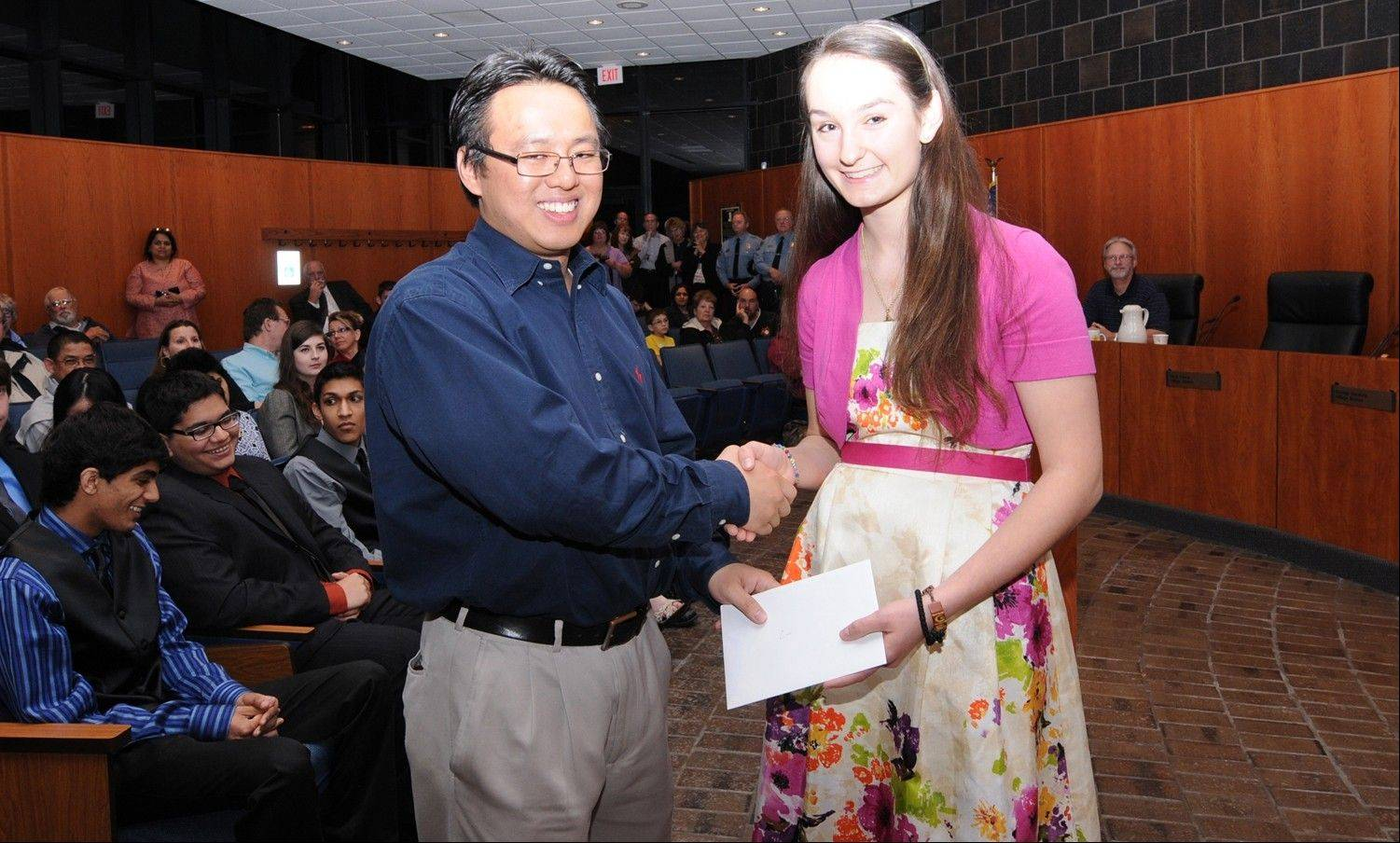 Former SYO musician Leo Chan presents the Leo Chan Alumni Scholarship to violist Evangelia Pagones.