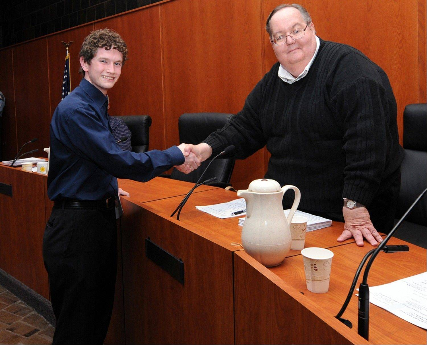 Schaumburg Trustee George Dunham presents the Kelliher--Lawless Scholarship to outstanding brass player Jacob VanDerBleek, who plays the tuba.