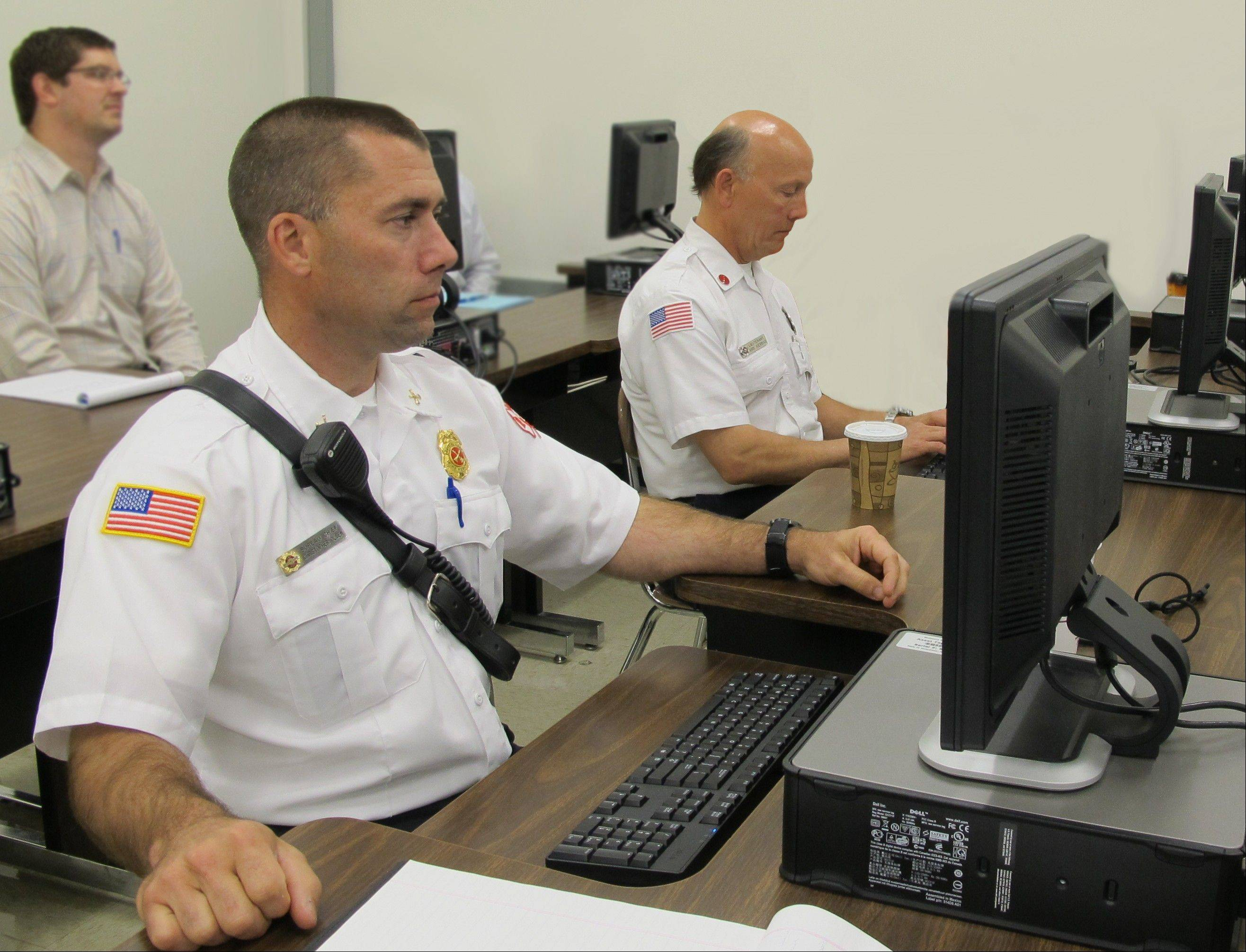 Crystal Lake first responders view Doppler radar on computer screens during a severe weather training session recently at McHenry County College. Representatives from Crystal Lake departments enhanced their skills to interpret radar using weather forecast models. Pictured from left are Crystal Lake Fire Deputy Chief Chris Olsen and Lt. Kirk Kiermas.