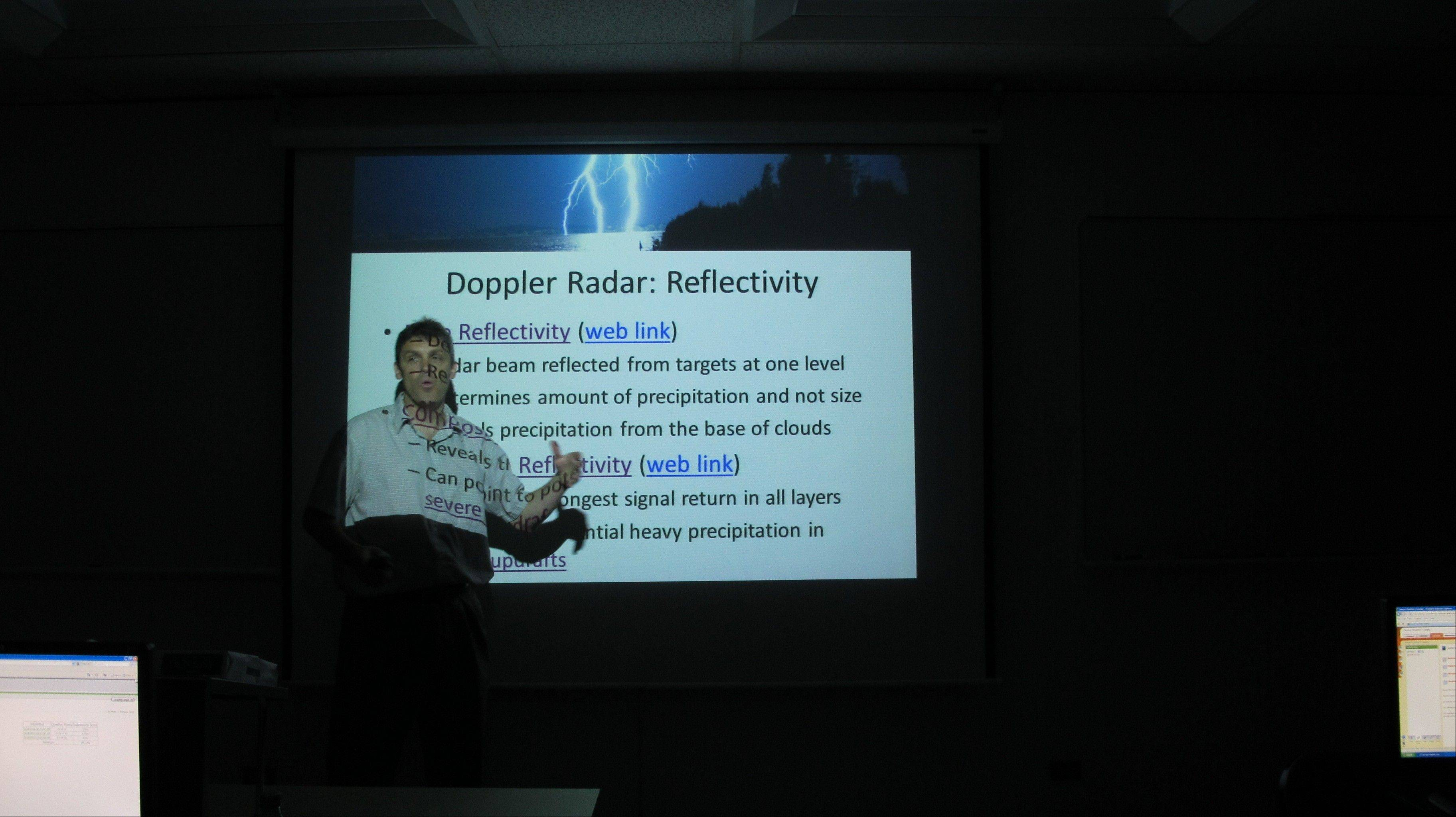MCC Earth Science instructor Paul Hamill explains an in-depth concept of Doppler radar to Crystal Lake first responders and city employees during a severe weather training session held recently at the College. He explained how to read Doppler radar correctly and what patterns to look for when assessing severe storms.