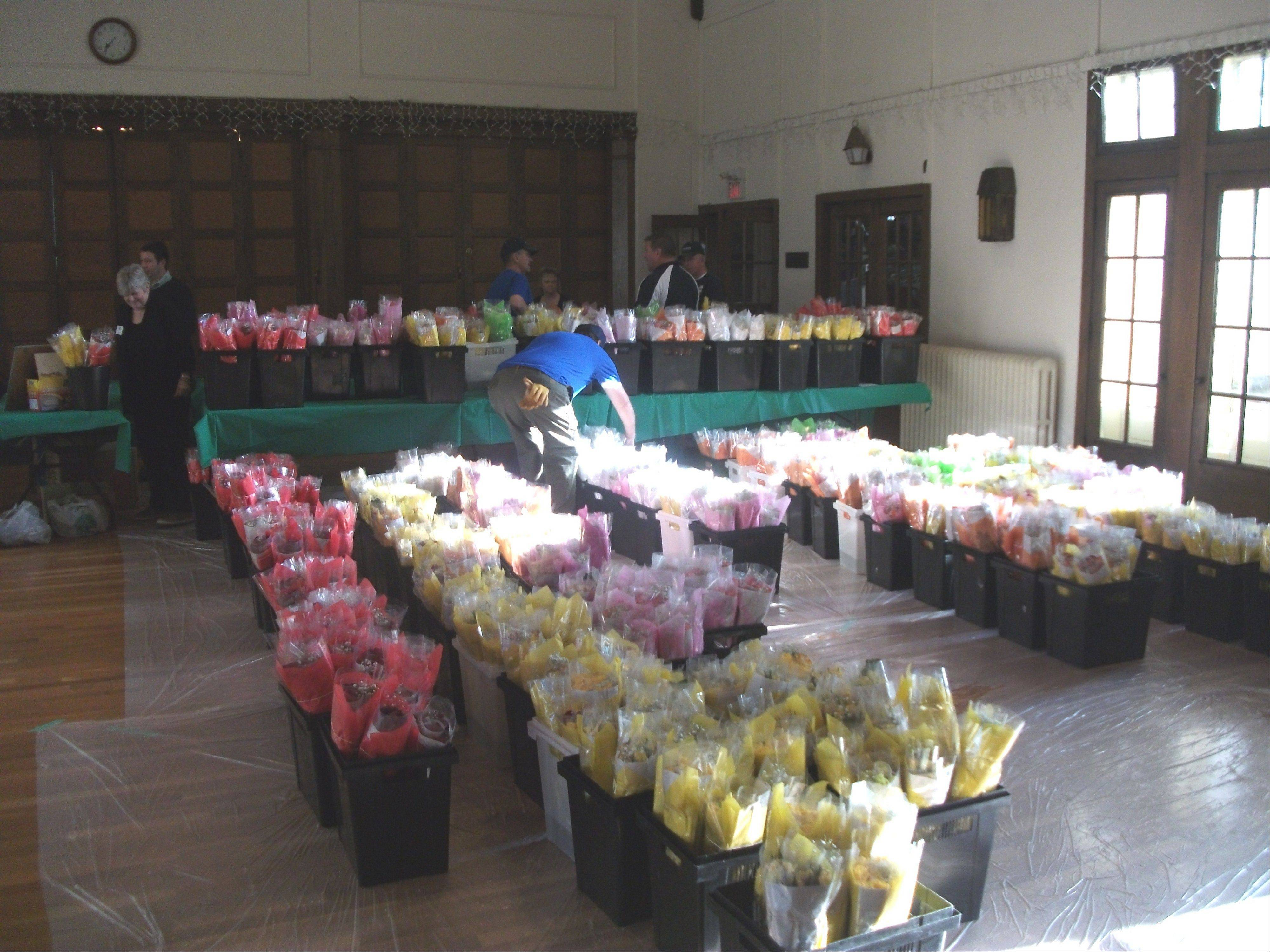 More than 1,200 dozen roses are lined up for pickup.