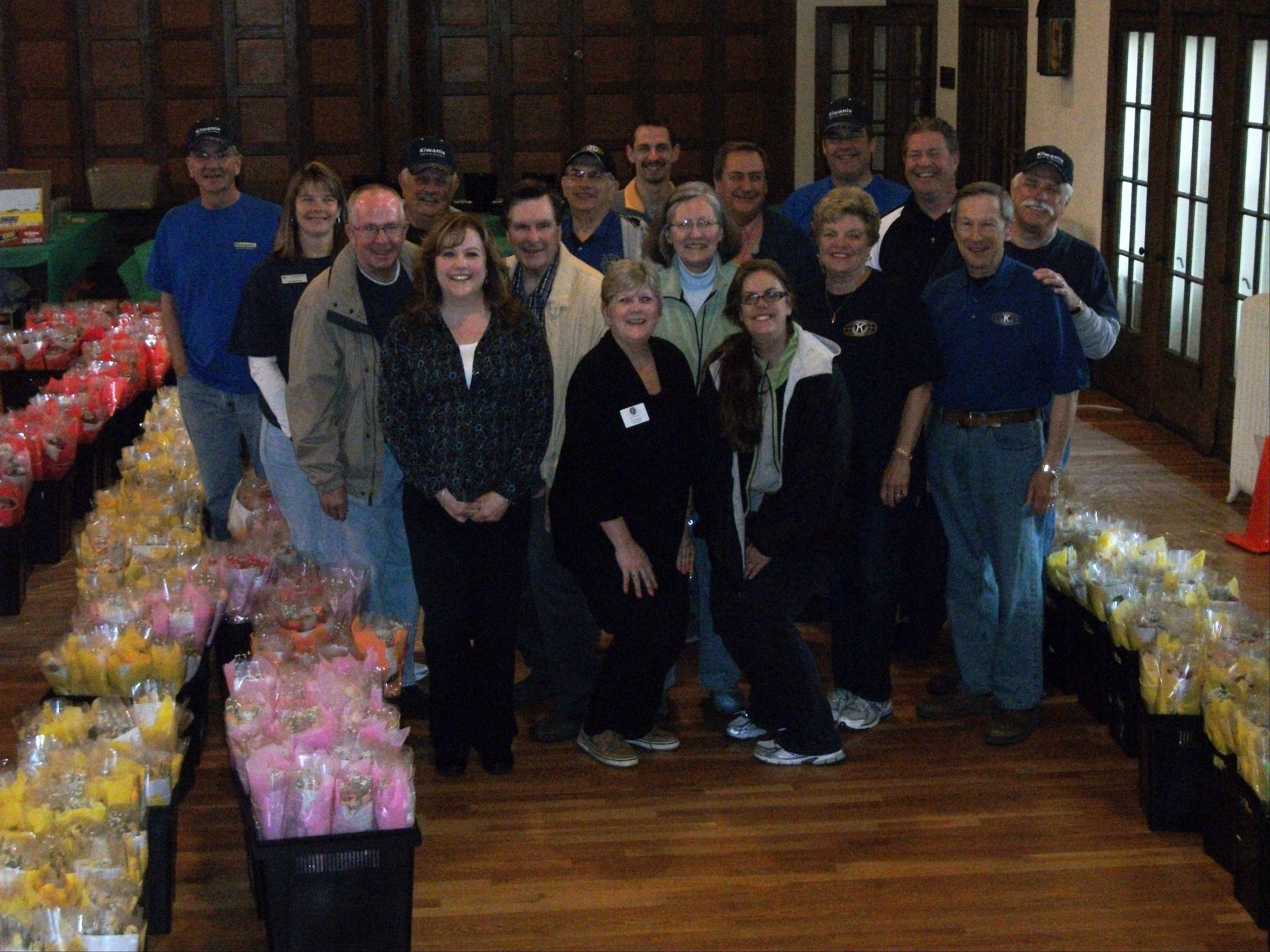 Kiwanians began arriving at 5:30 a.m. and worked until late afternoon to make sure the more than 1,200 dozen roses were delivered.