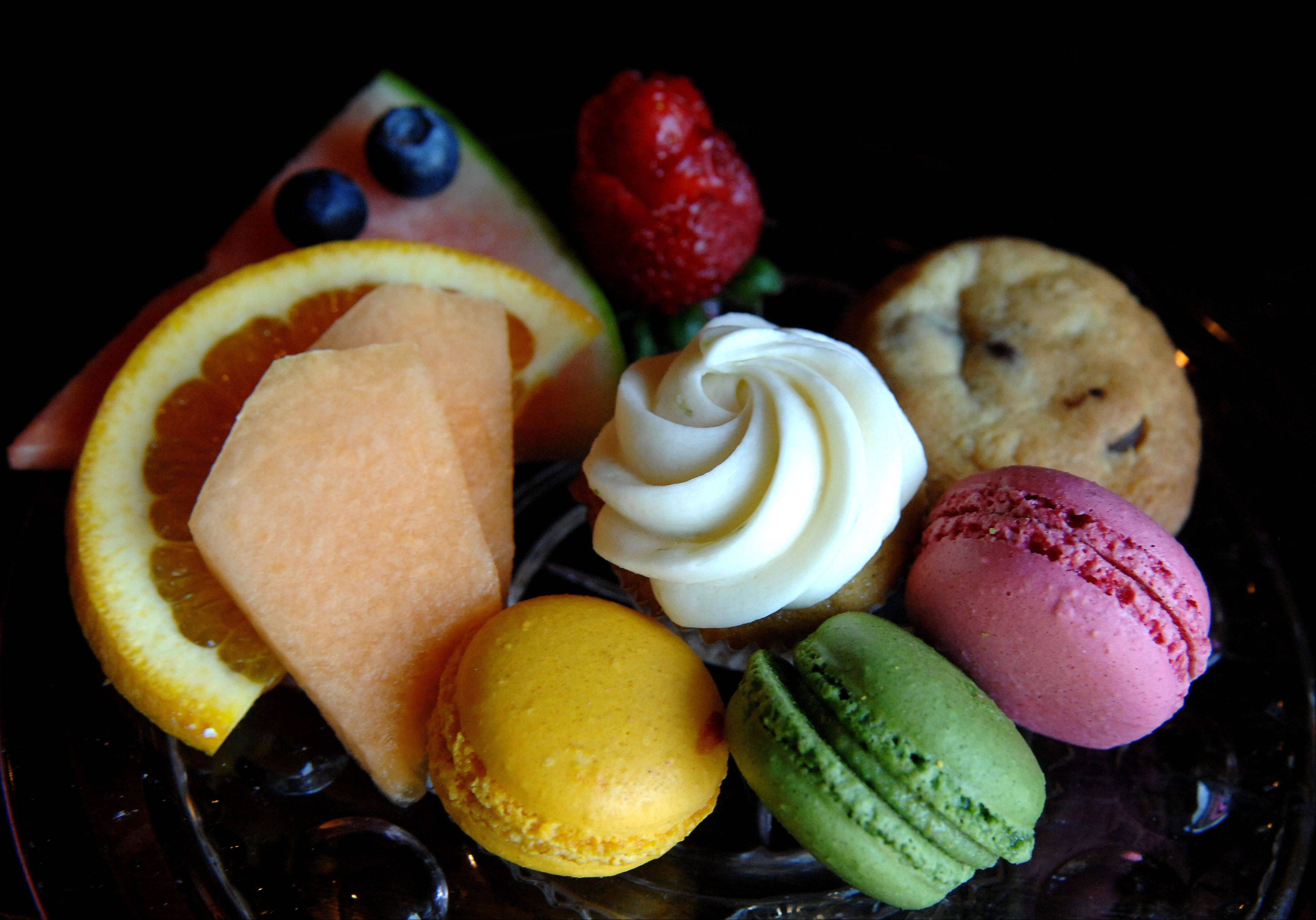 A plate of sweets and fruit tempts those who wonder into Chez Moi in Geneva.