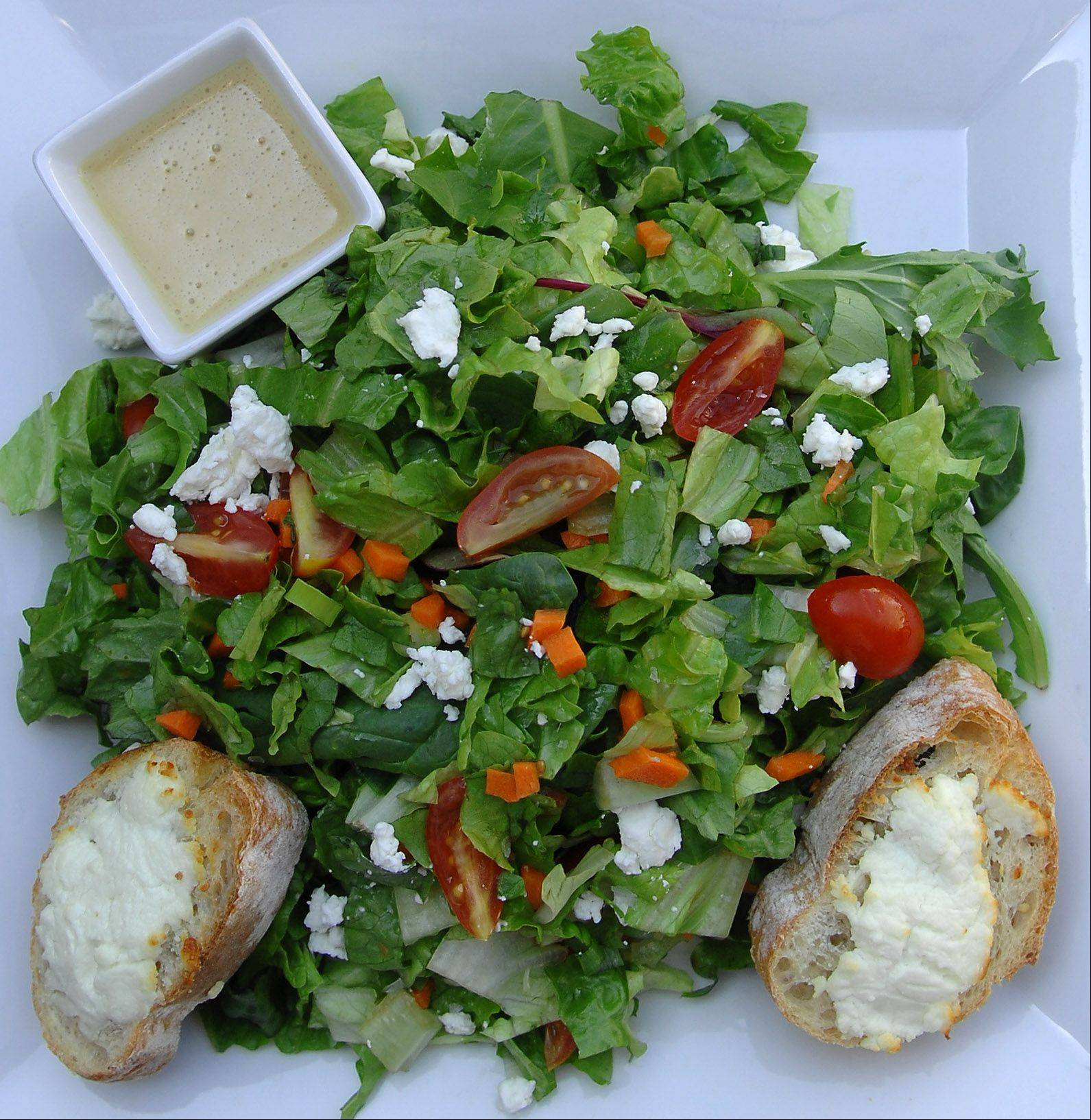 Chez Moi offers a warm goat cheese crostini salad on its lunch menu.