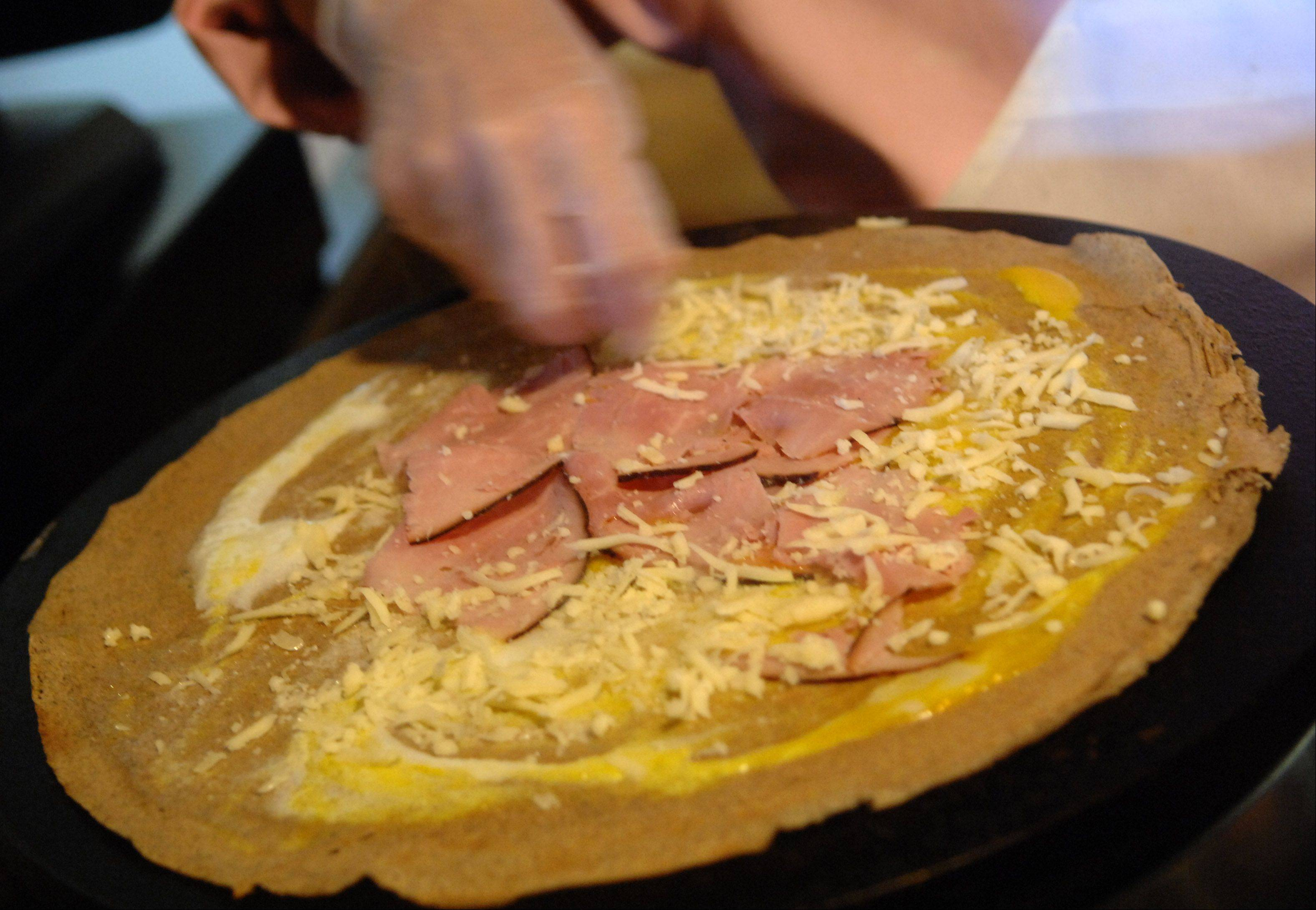 Elizabeth Cull makes a ham, egg and gruyere galette at her bistro, Chez Moi in Geneva.