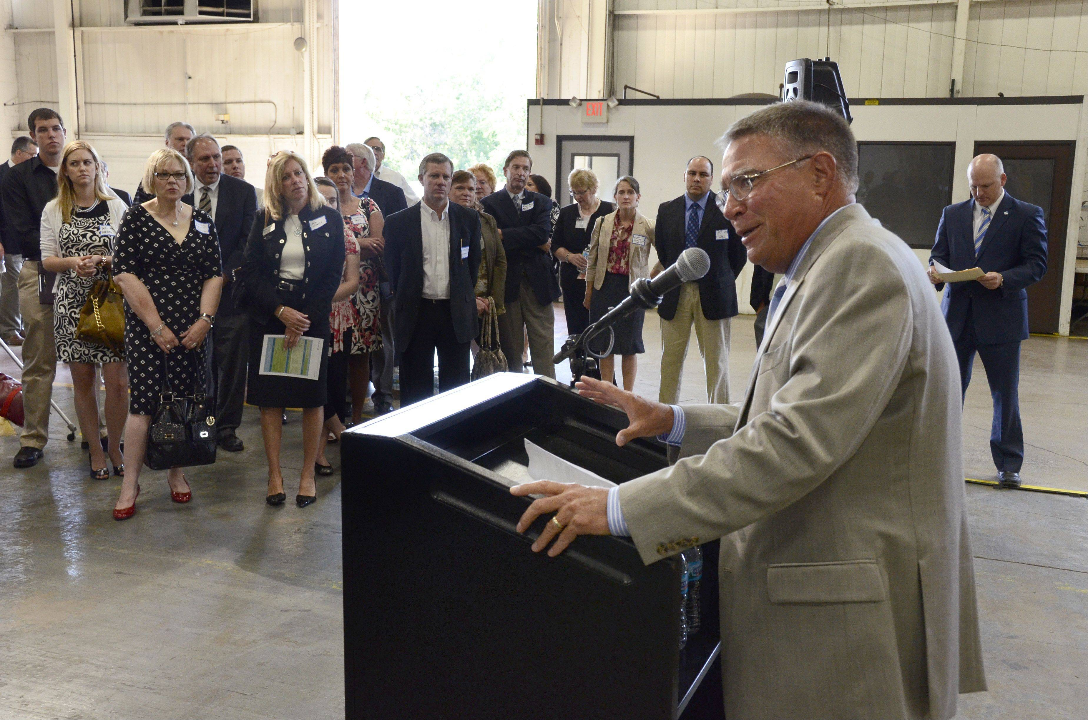 Harper College President Ken Ender, speaking Wednesday at a news conference at Acme Industries in Elk Grove Village, formally announces the partnership between the Palatine community college and more than 50 manufacturers creating a new Advanced Manufacturing program.
