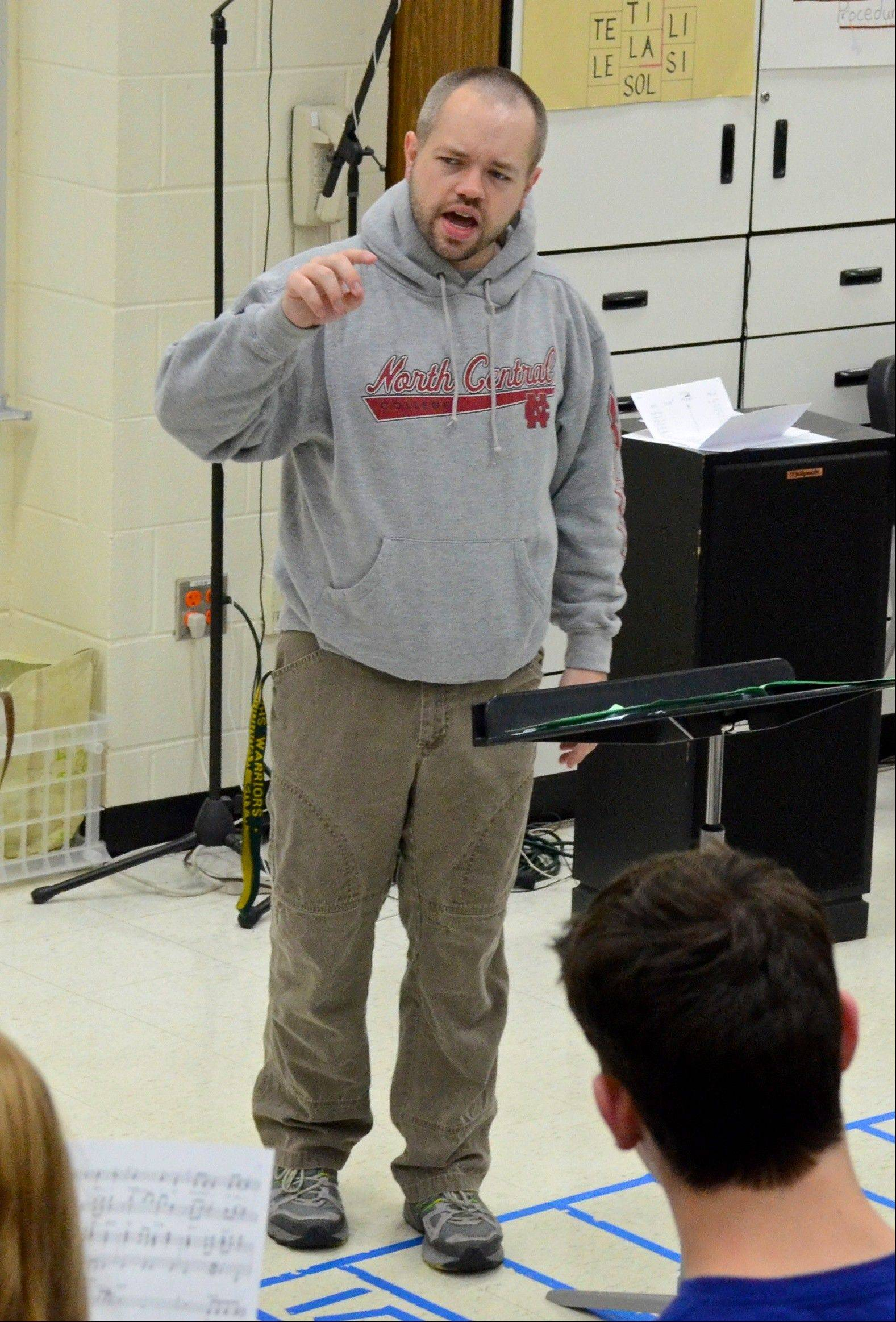 Mark Myers works with students during a rehearsal.