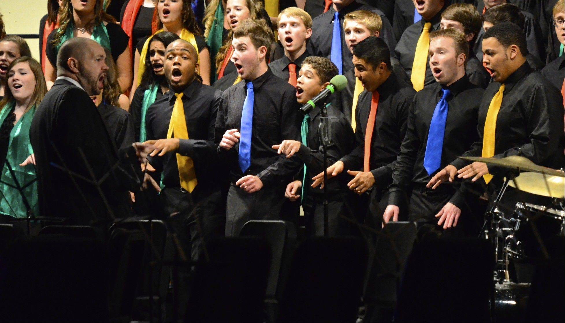 "Choral director Mark Myers leads Waubonsie Valley students during a concert. ""It truly is my job and my hobby,"" he says."