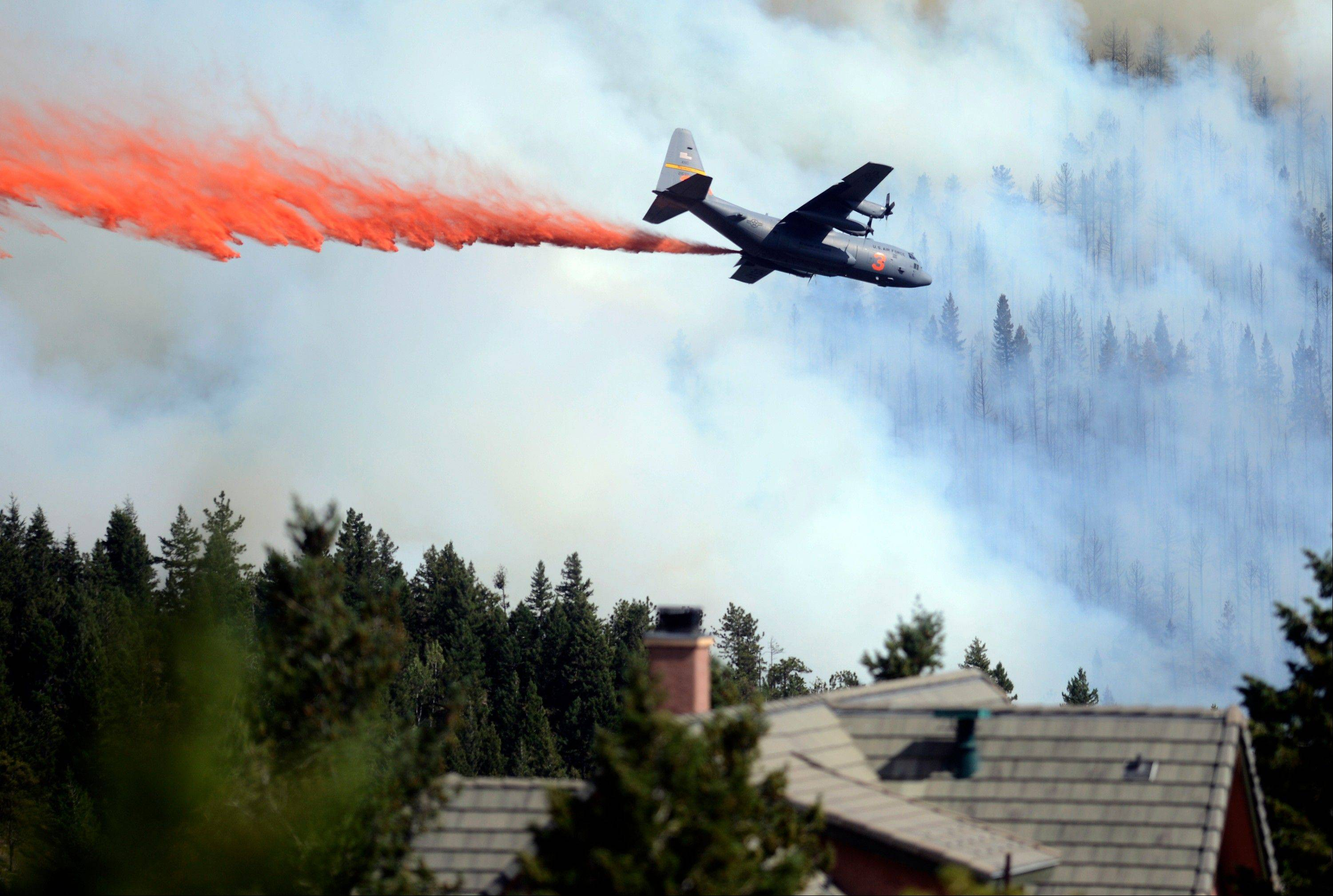 A heavy tanker drops fire retardant while fighting the Flagstaff wildfire on Tuesday, June 26, 2012 in Boulder, Colorado.