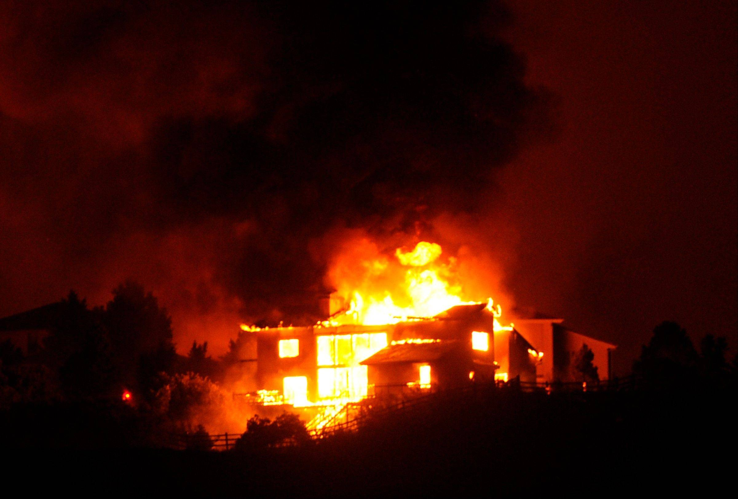 The Waldo Canyon fire engulfs a large structure as it made a run into Colorado Springs Tuesday night, June 26, 2012.