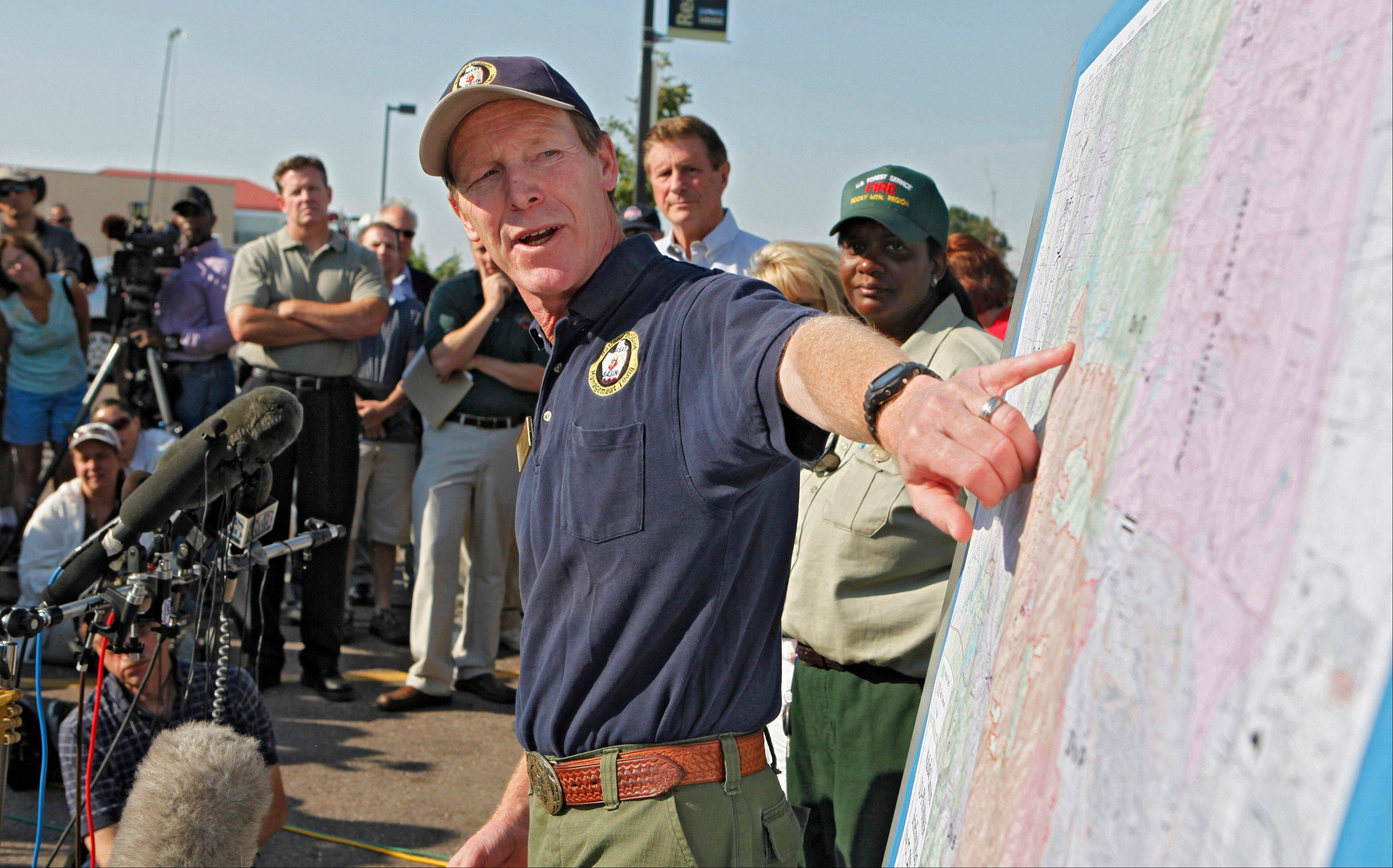 Incident Commander Rich Harvey uses a map as he talks about the Waldo Canyon wildfire during a briefing in Colorado Springs, Colo., on Wednesday, June 27, 2012. Authorities say it remains too dangerous for them to fully assess the damage from a destructive wildfire threatening Colorado's second-largest city.