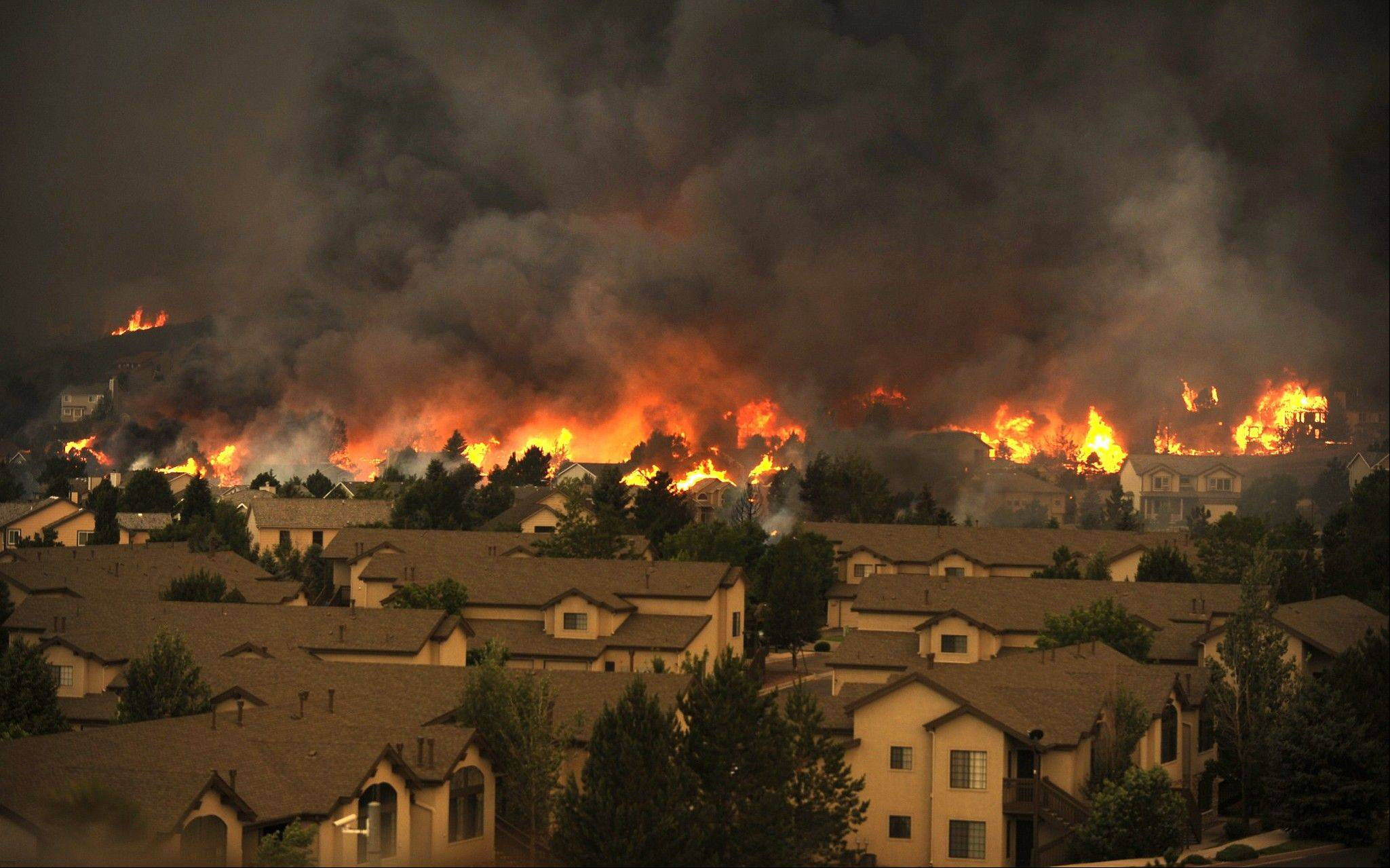 An entire neighborhood burns near the foothills of Colorado Springs, Colo., Tuesday, June 26, 2012. Colorado has endured nearly a week of 100-plus-degree days and low humidity, sapping moisture from timber and grass, creating a devastating formula for volatile wildfires across the state and punishing conditions for firefighters.