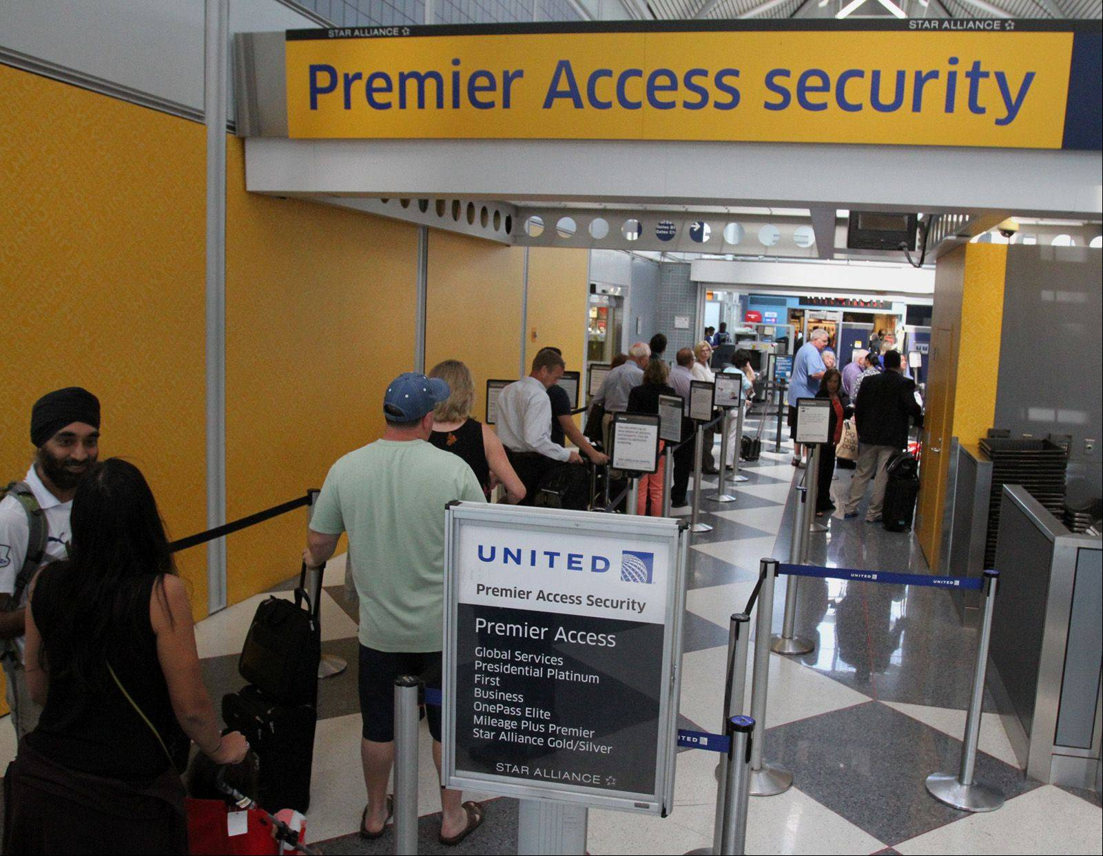 Passengers check in to see if they can go through a new streamlined security checkpoint for preapproved travelers at the United Terminal at O'Hare International Airport in Chicago on Wednesday.
