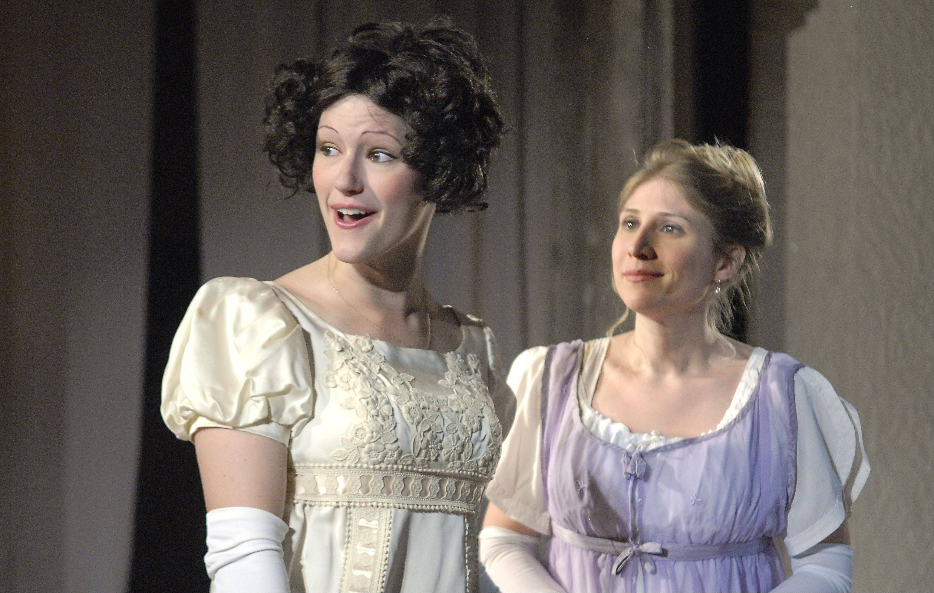 "Cady Leinicke of Chicago is Elizabeth Bennet, left, and Megan Campbell of Chicago is her friend, Charlotte Lucas, in the Janus Theater production of ""Pride and Predjudice"" at the Elgin Art Showcase."