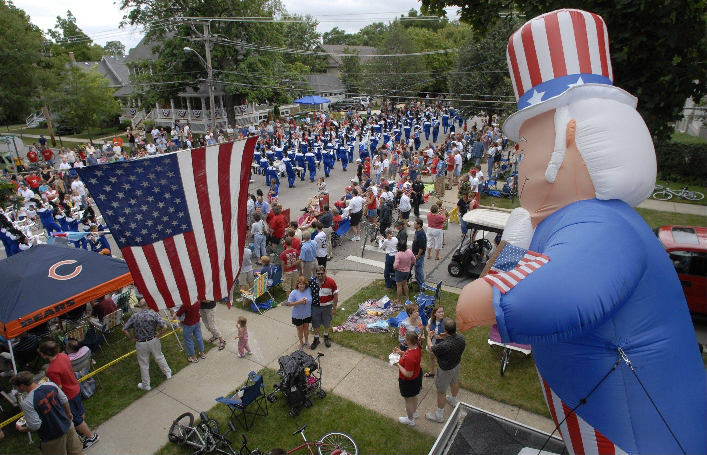 Arlington Heights' July 4 parade is one of the biggest in the Chicago area, and this year will have a New York City firetruck that responded to the 9/11 disaster.