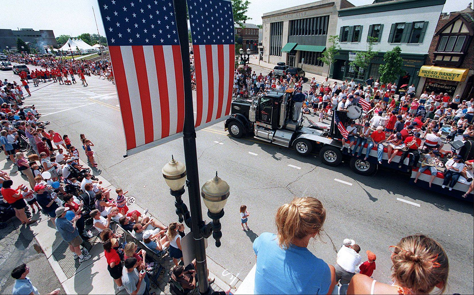 Thousands of people line Main Street each year for Barrington's Fourth of July parade.