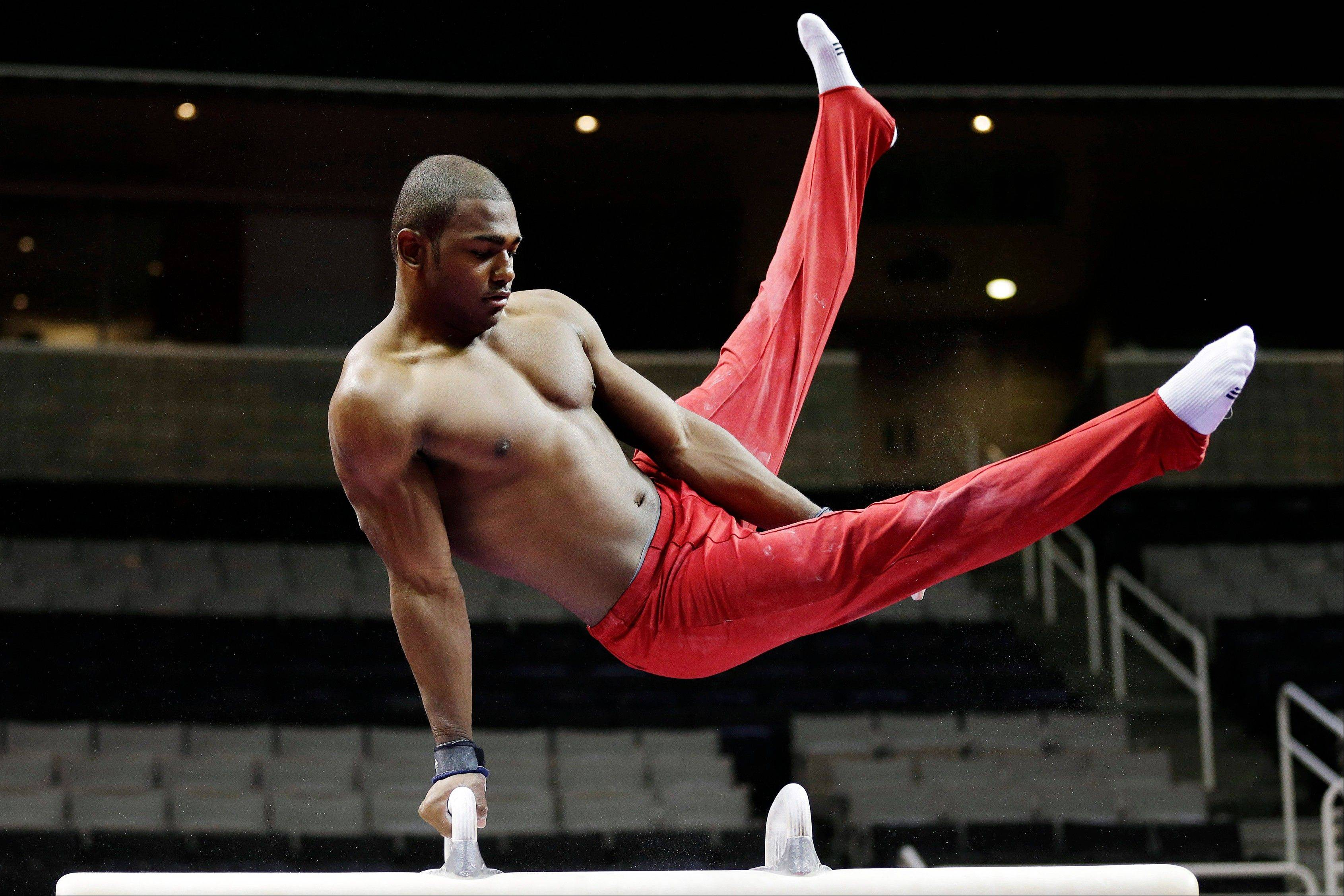 John Orozco trains on the pommel horse during practice for the U.S. Olympic gymnastics trials Wednesday in San Jose, Calif.