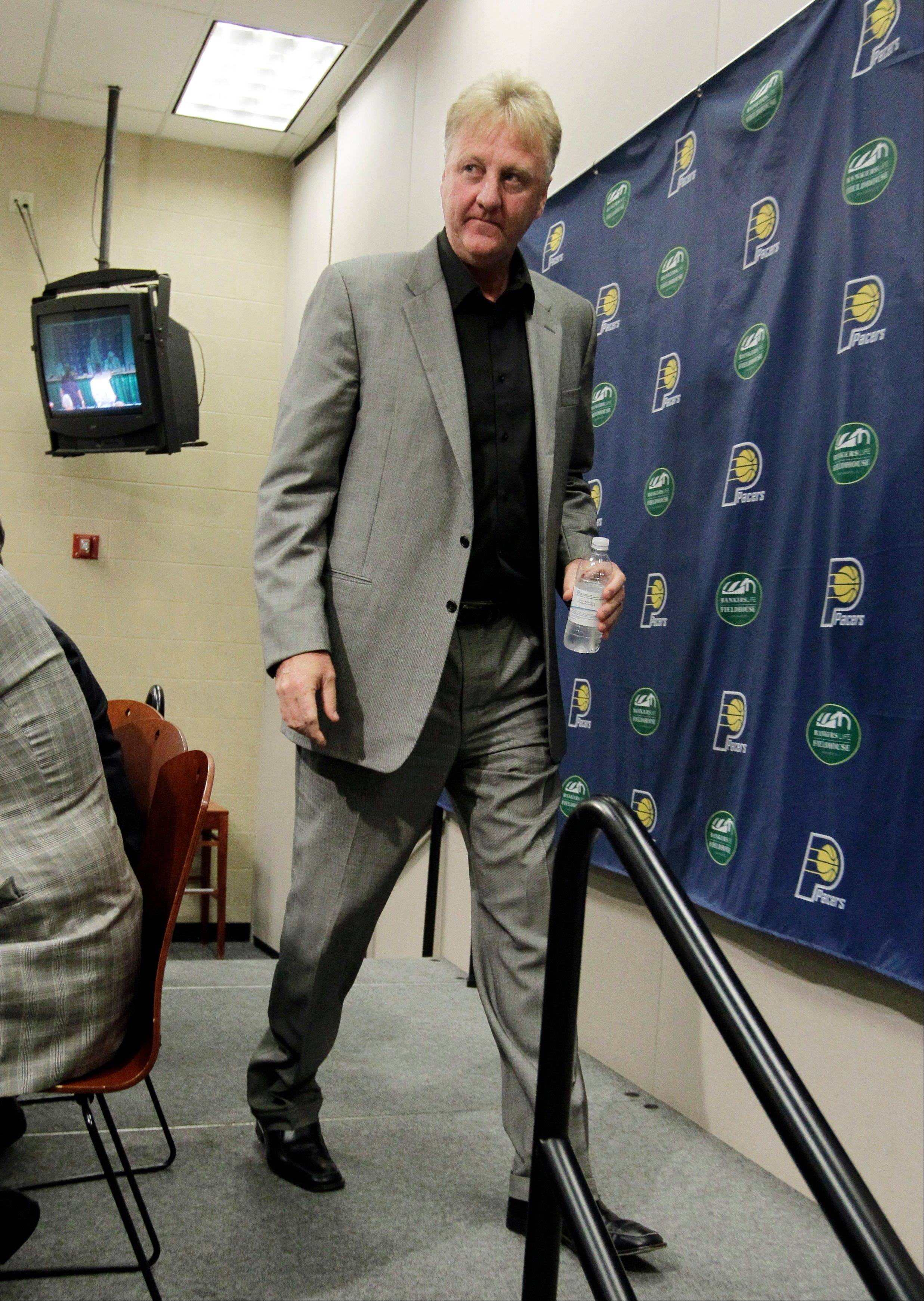 Larry Bird leaves the stage after announcing Wednesday that he is stepping down as president of the Indiana Pacers. Donnie Walsh was named as president and Kevin Pritchard as general manager.